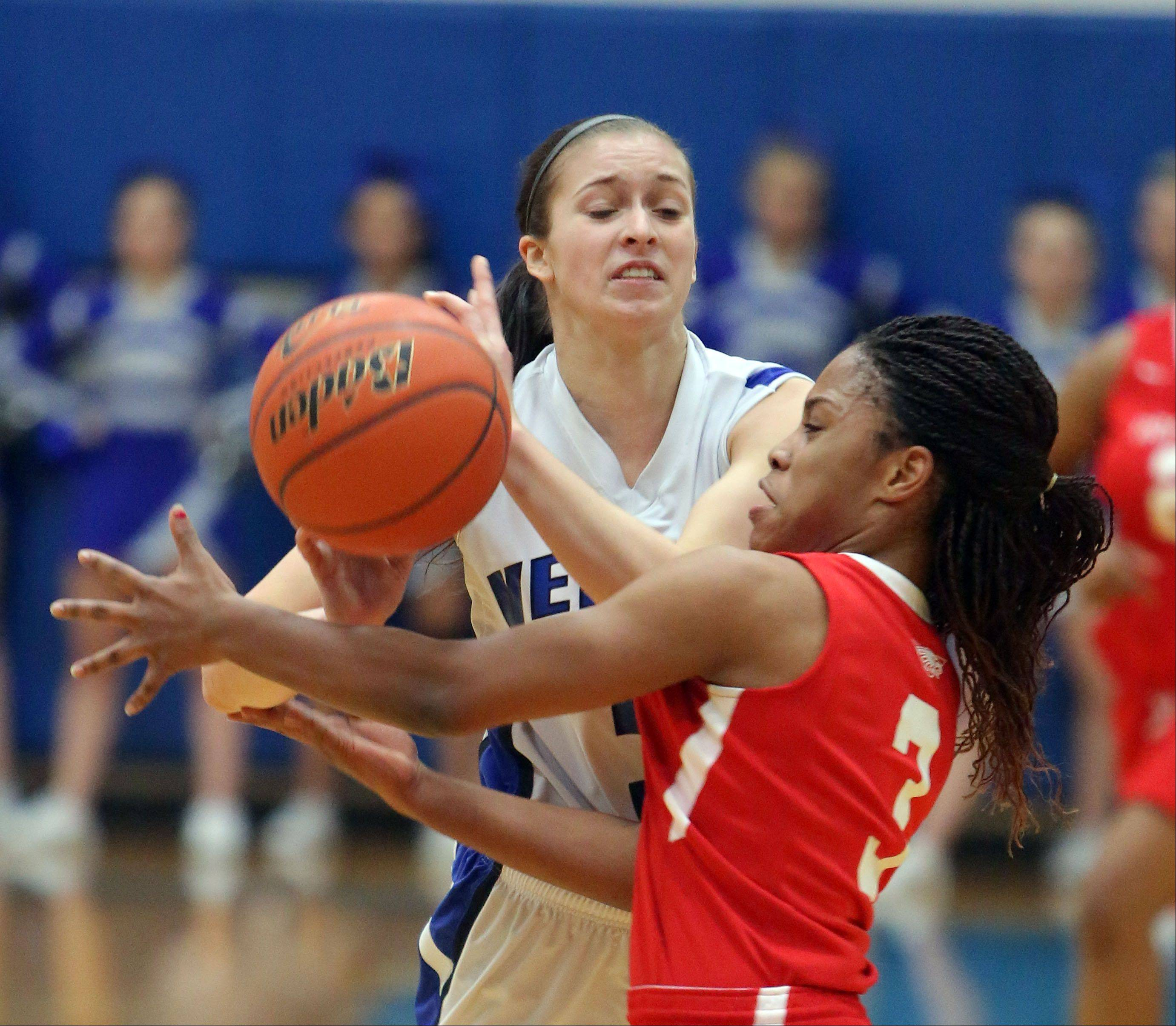 Vernon Hills' Dana Meline, left, and North Chicago's Alexis Means scramble for a loose ball.