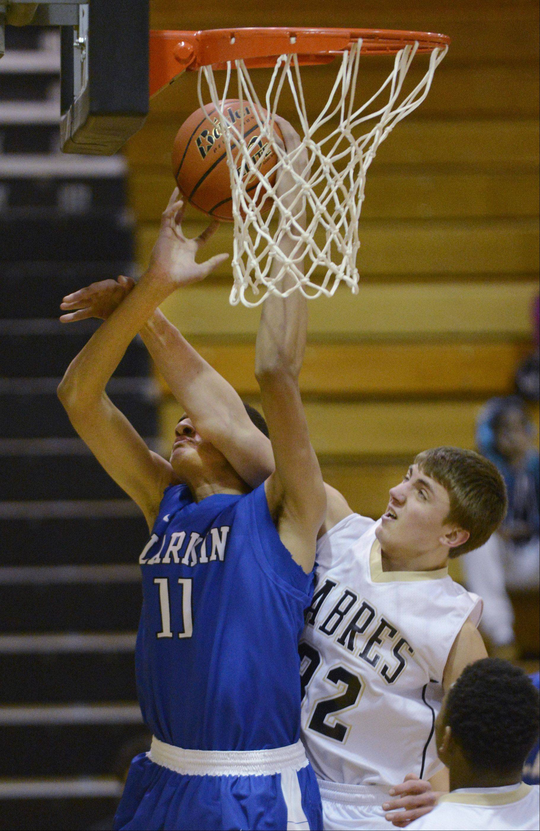 Streamwood's Cole Seger fouls Larkin's Christian Negron Wednesday in Streamwood.