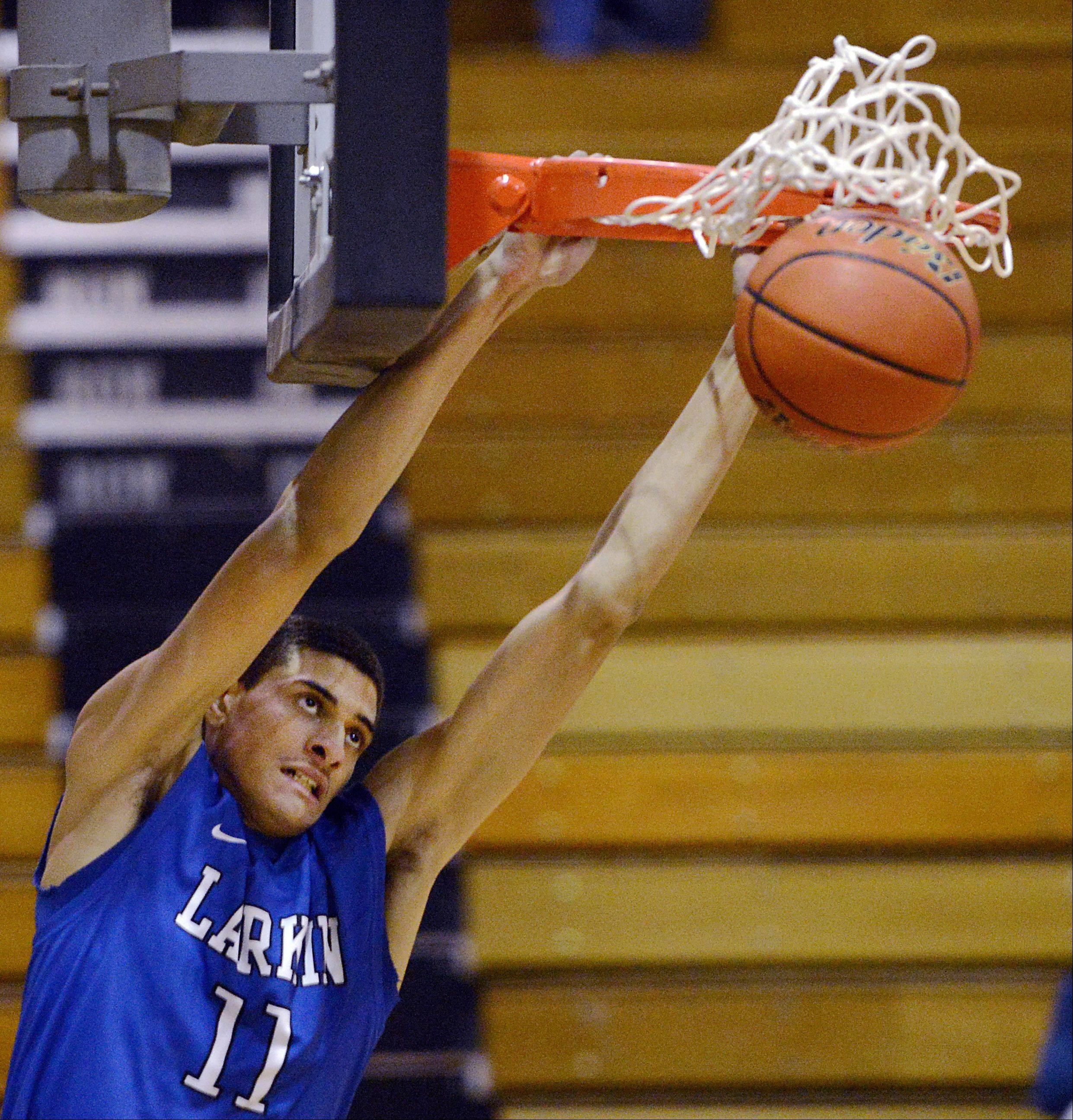 Larkin's Christian Negron slams the first points of the game Wednesday in Streamwood.