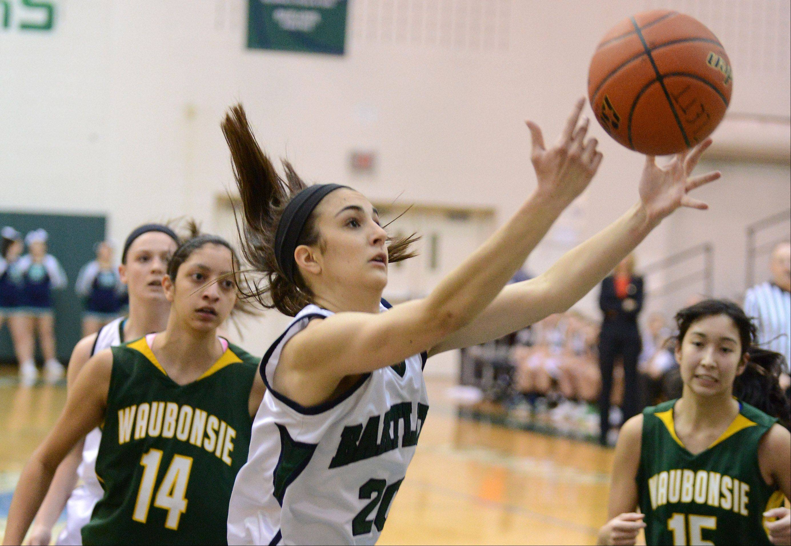 Bartlett's Elizabeth Arco (20) grabs a rebound during Thursday's game in Bartlett.