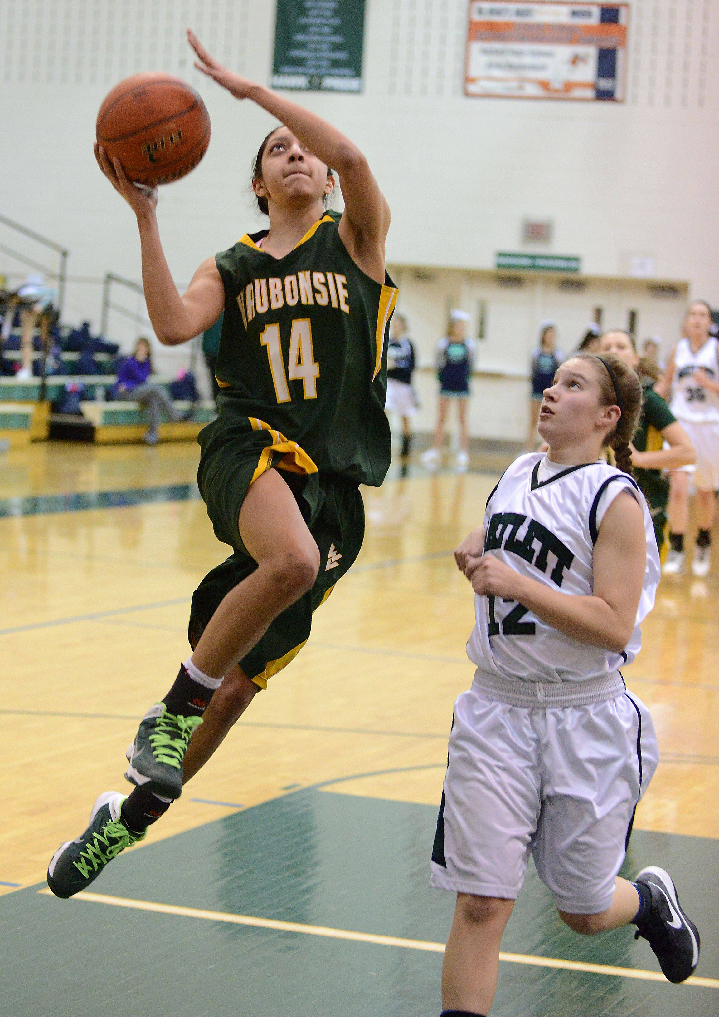 Waubonsie Valley's Andrea Colin scores on a breakaway as Bartlett's Ashley Johnson looks on.
