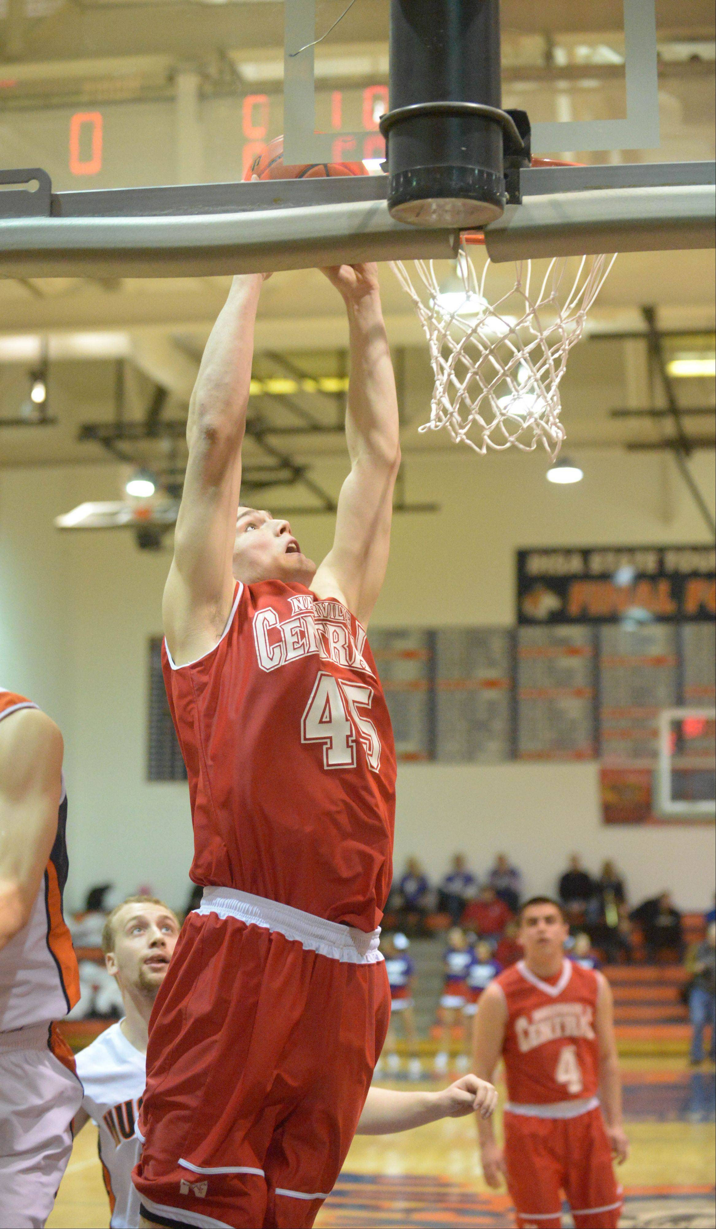 Paul Michna/pmichna@dailyherald.com Nick Czarnowski of Naperville Central goes up for the dunk during the Naperville Central at Naperville North boys basketball game Friday.
