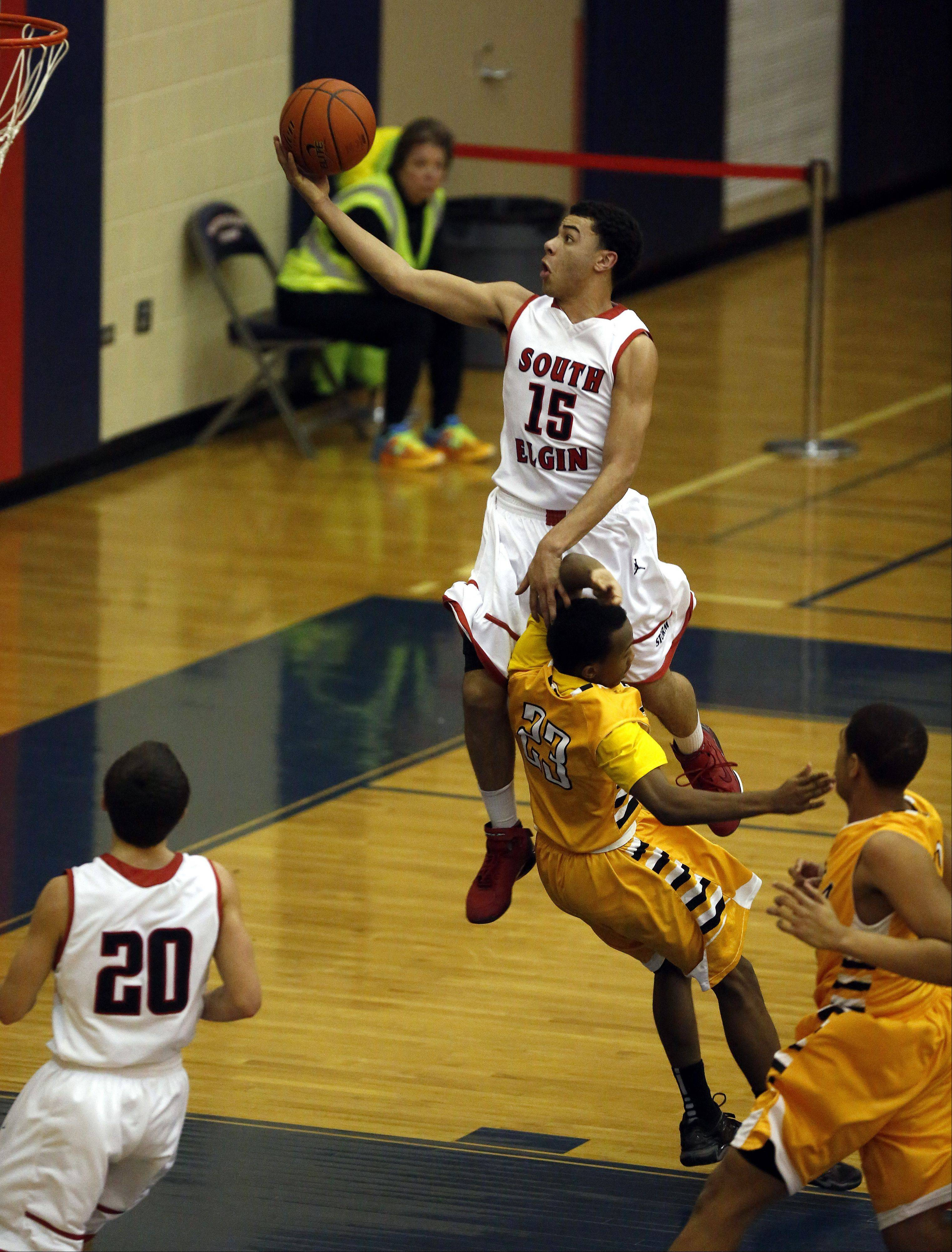 South Elgin's Matthew Smith goes up and over Metea Valley's Ron Edwards Jr. at South Elgin Friday.