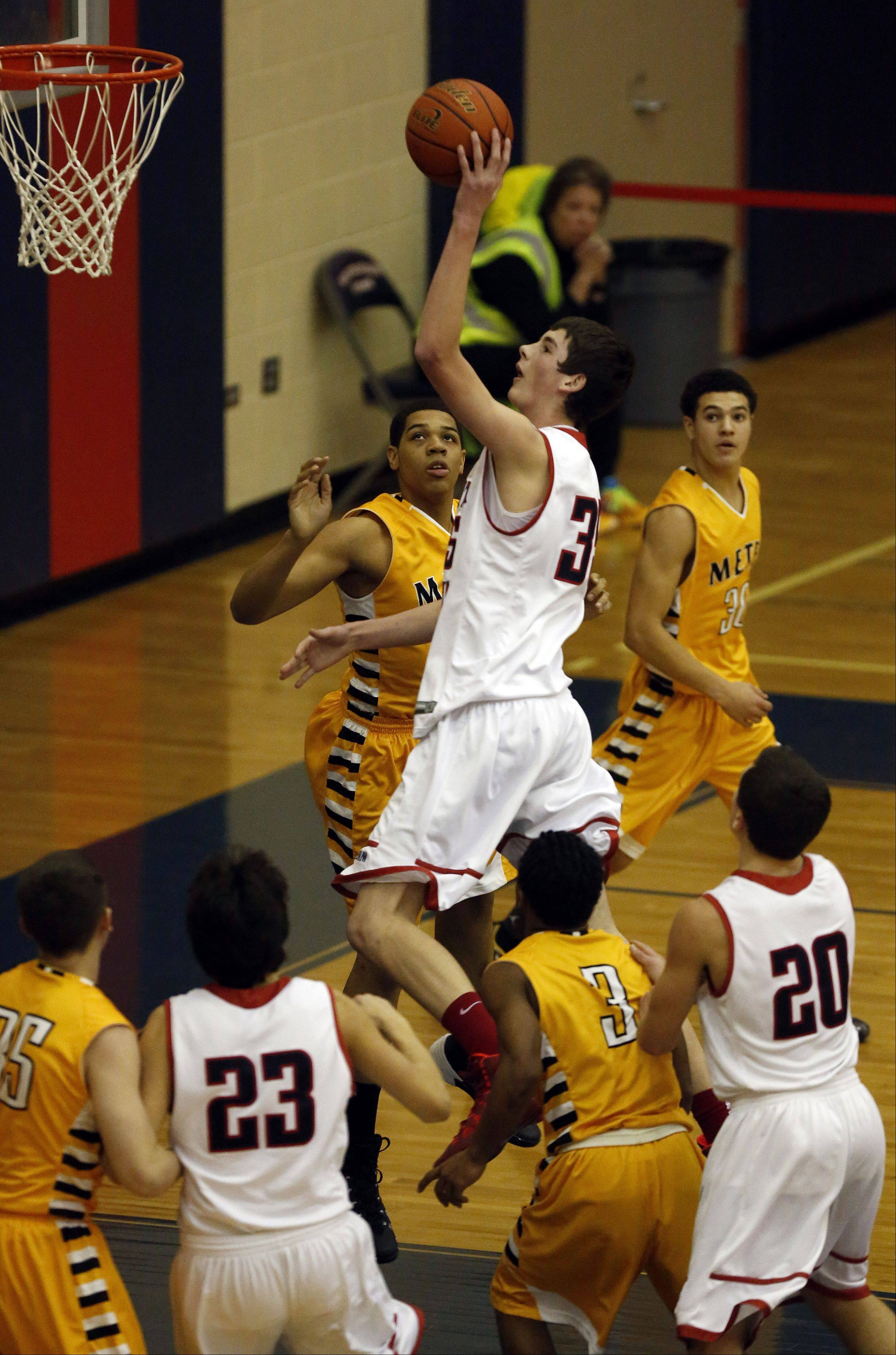 South Elgin's Tyler Hankins goes strong to the hoop against Metea Valley at South Elgin Friday.