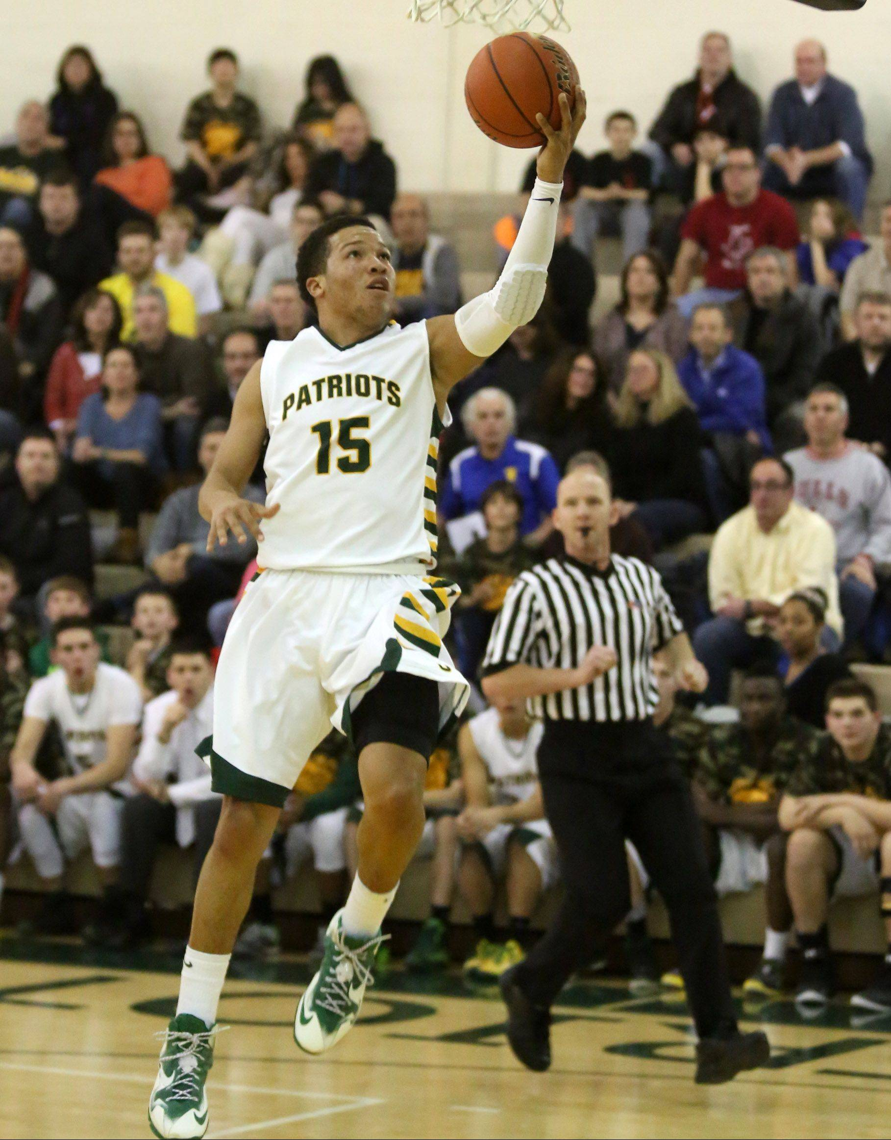 Stevenson's Jalen Brunson gets free for a drive to basket against Libertyville at Stevenson on Friday.