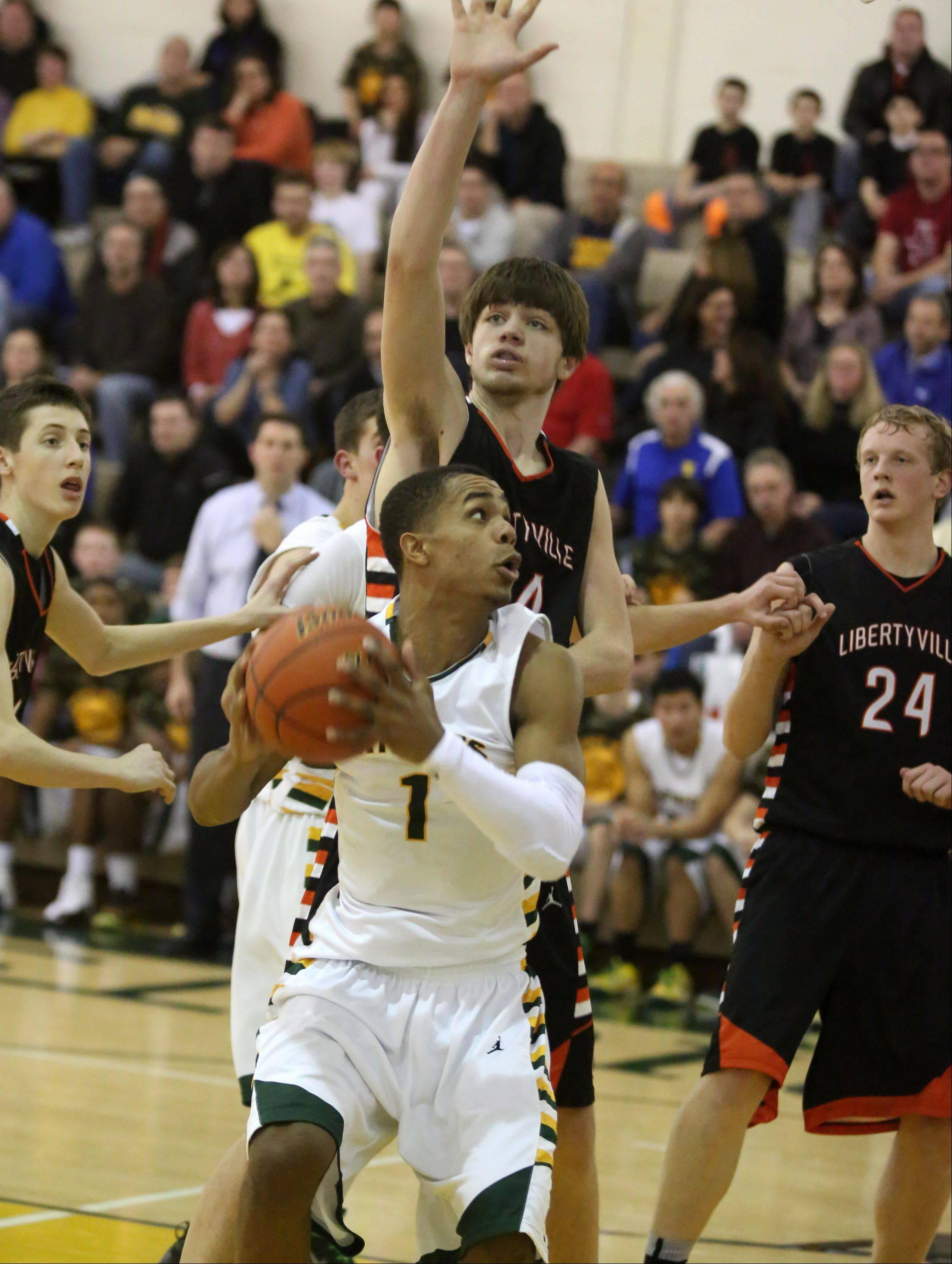 Stevenson guard Connor Cashaw looks to shoot against Libertyville center Joe Borcia.