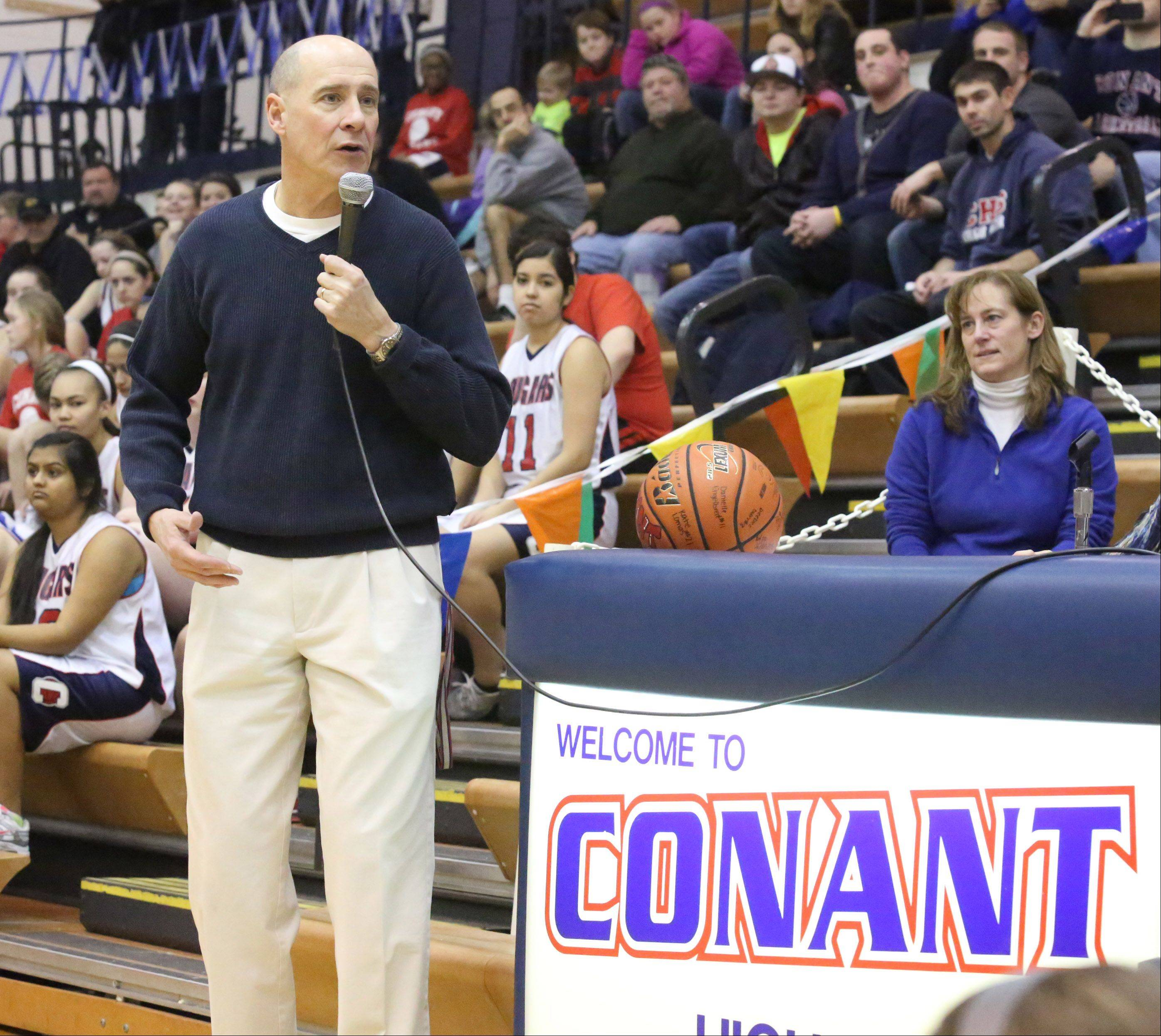 Conant girls basketball coach Dan Travers says a thank you to his players and fans after receiving a plaque from athletic director John Kane on Saturday before a game with Crystal Lake South at Conant.