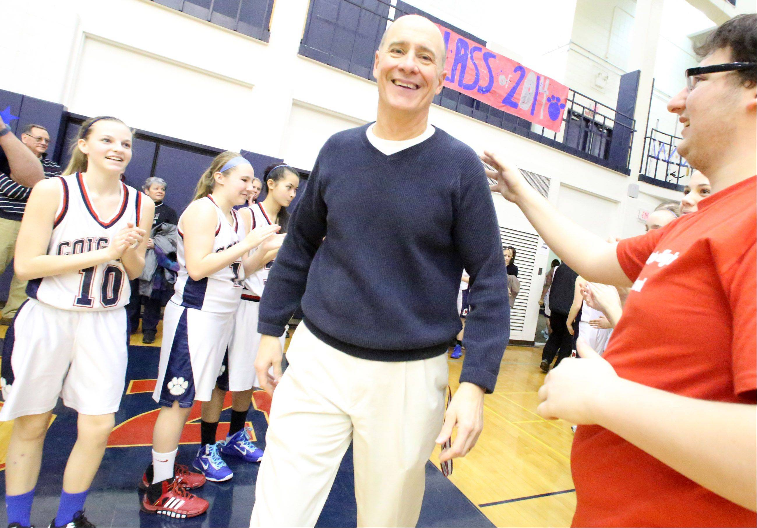 Dan Travers, Conant head girls varsity coach, takes the floor on Saturday for a game with Crystal Lake South at Conant in Hoffman Estates.
