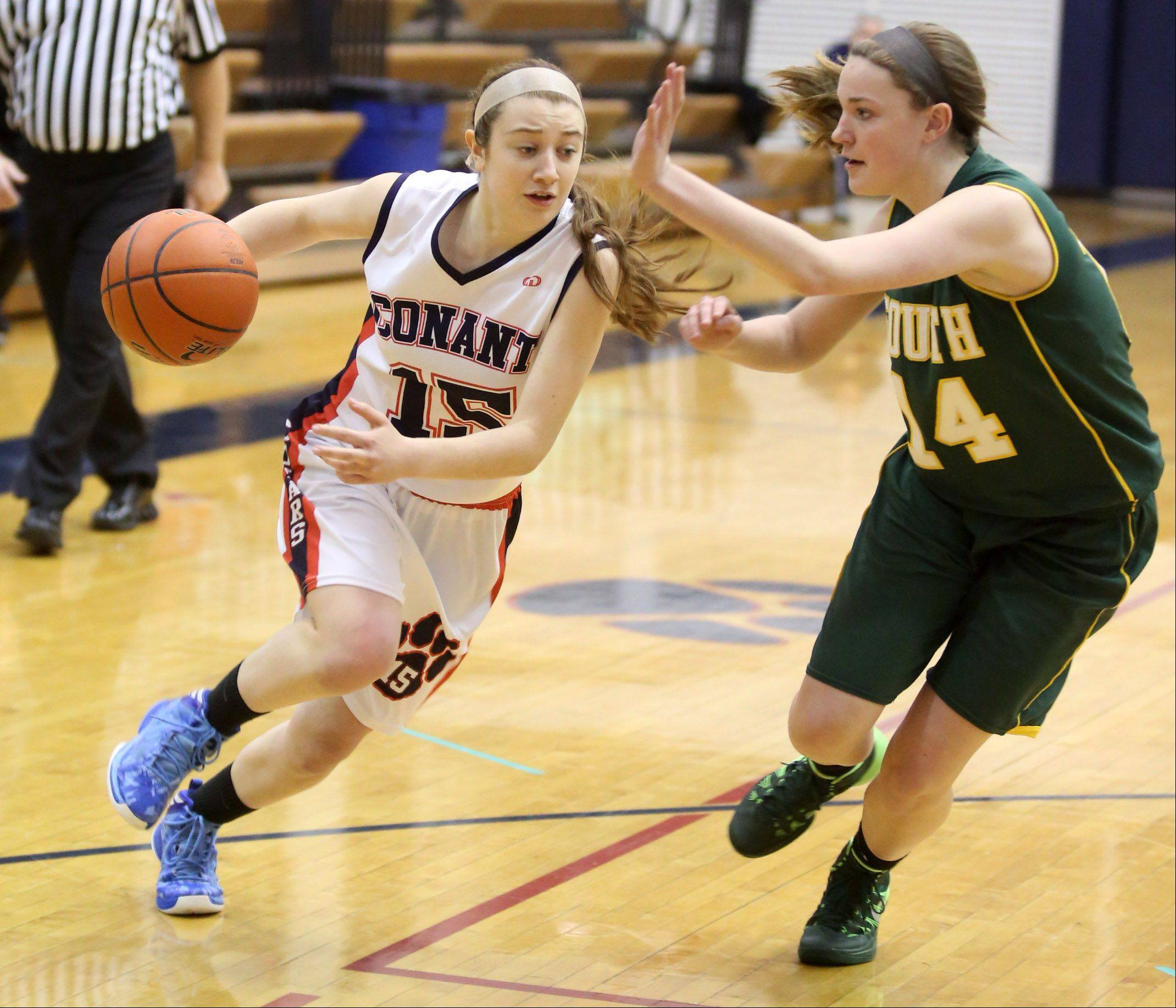 Conant's Lexi Zades pushes the ball up court against Crystal Lake South defender Chanel Fanter at Conant on Saturday.
