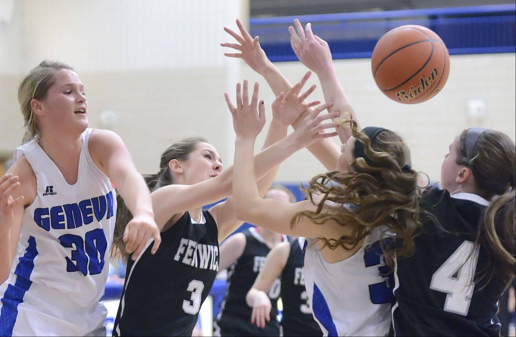 Geneva's Janie McCloughan (30) and Madeline Dunn (33) scramble for the loose ball with Fenwick's Katie Dvorak (3) and Megan Hussey (4) in the second quarter on Wednesday, January 29.