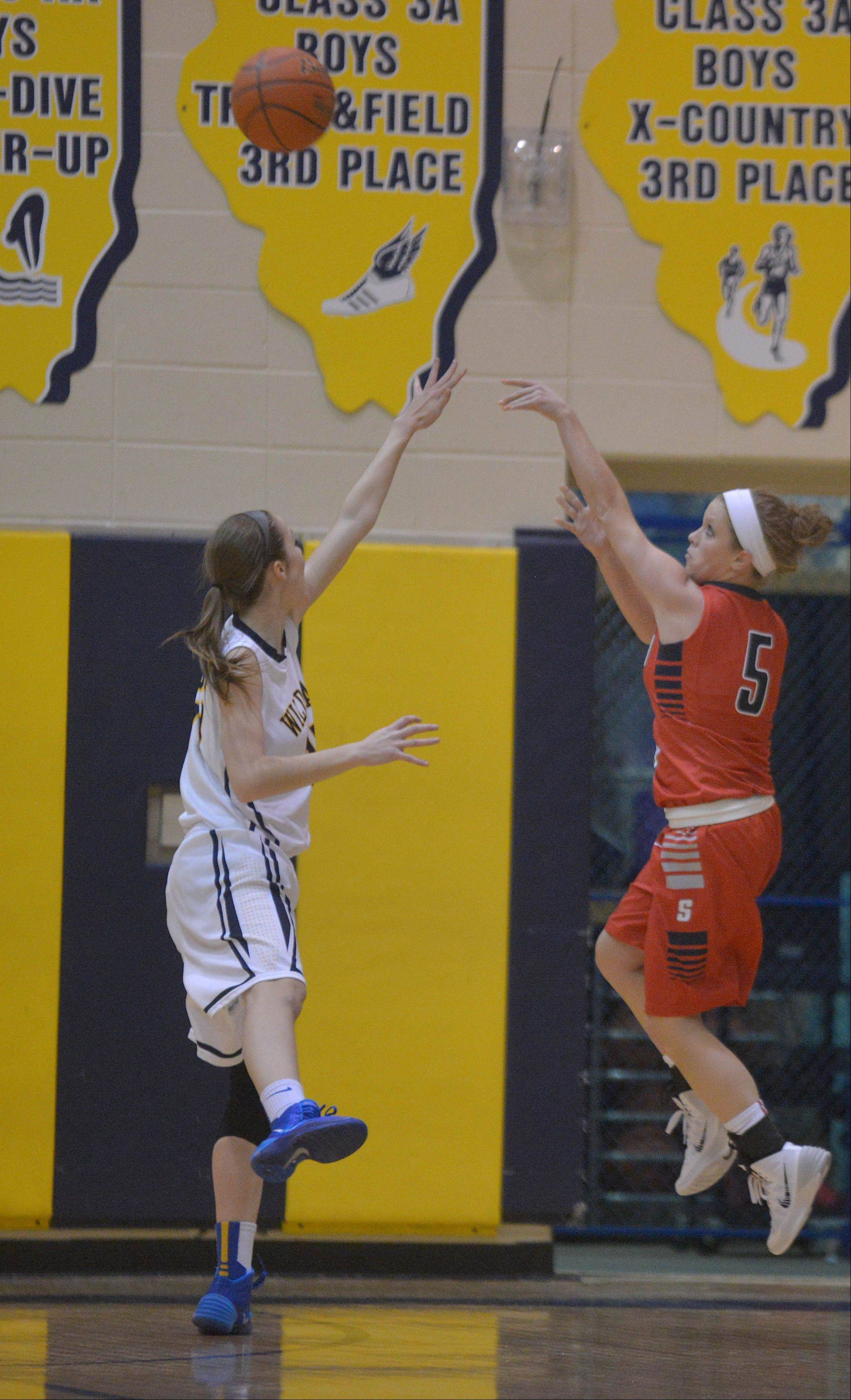Megan Keefer of Neuqua attempts to block a shot from Anna Tracy of South Elgin during the South Elgin at Neuqua Valley girls basketball game Wednesday.