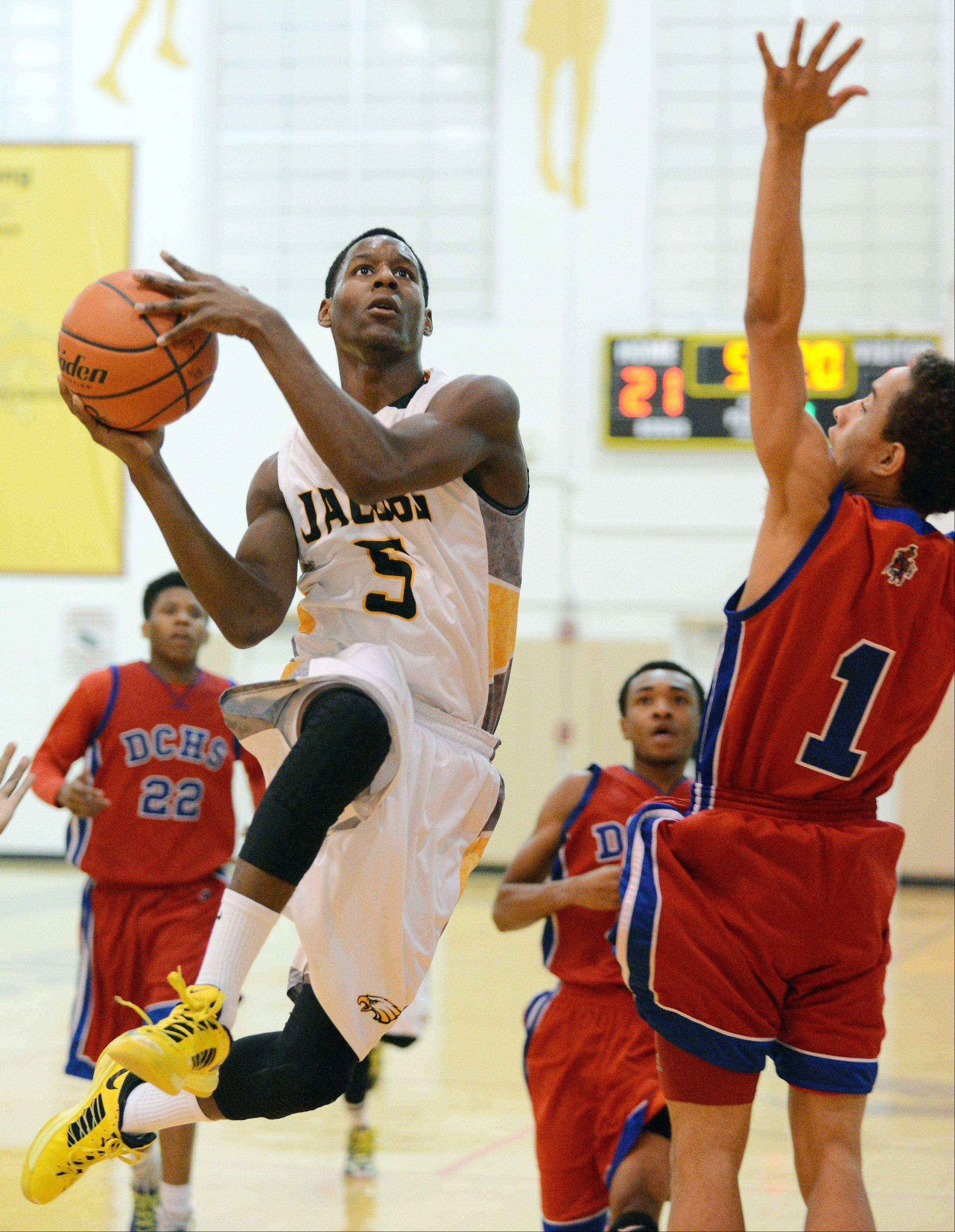 Chris Orange of Jacobs drives to the basket for two points against Dundee-Crown during Wednesday's game in Algonquin.