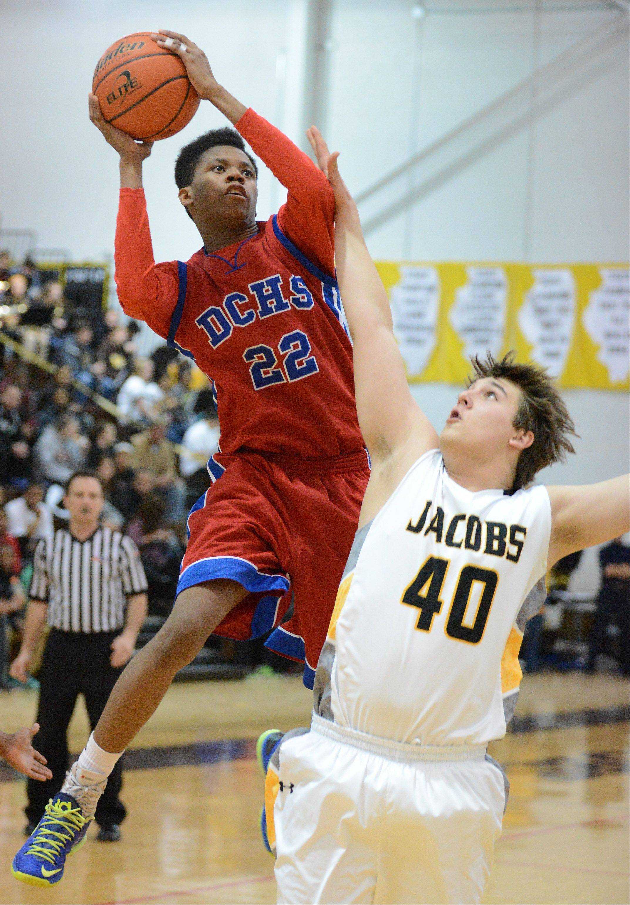 Dundee-Crown's Juwan Stewart shoots and scores over Matt Bindi of Jacobs during Wednesday's game in Algonquin.