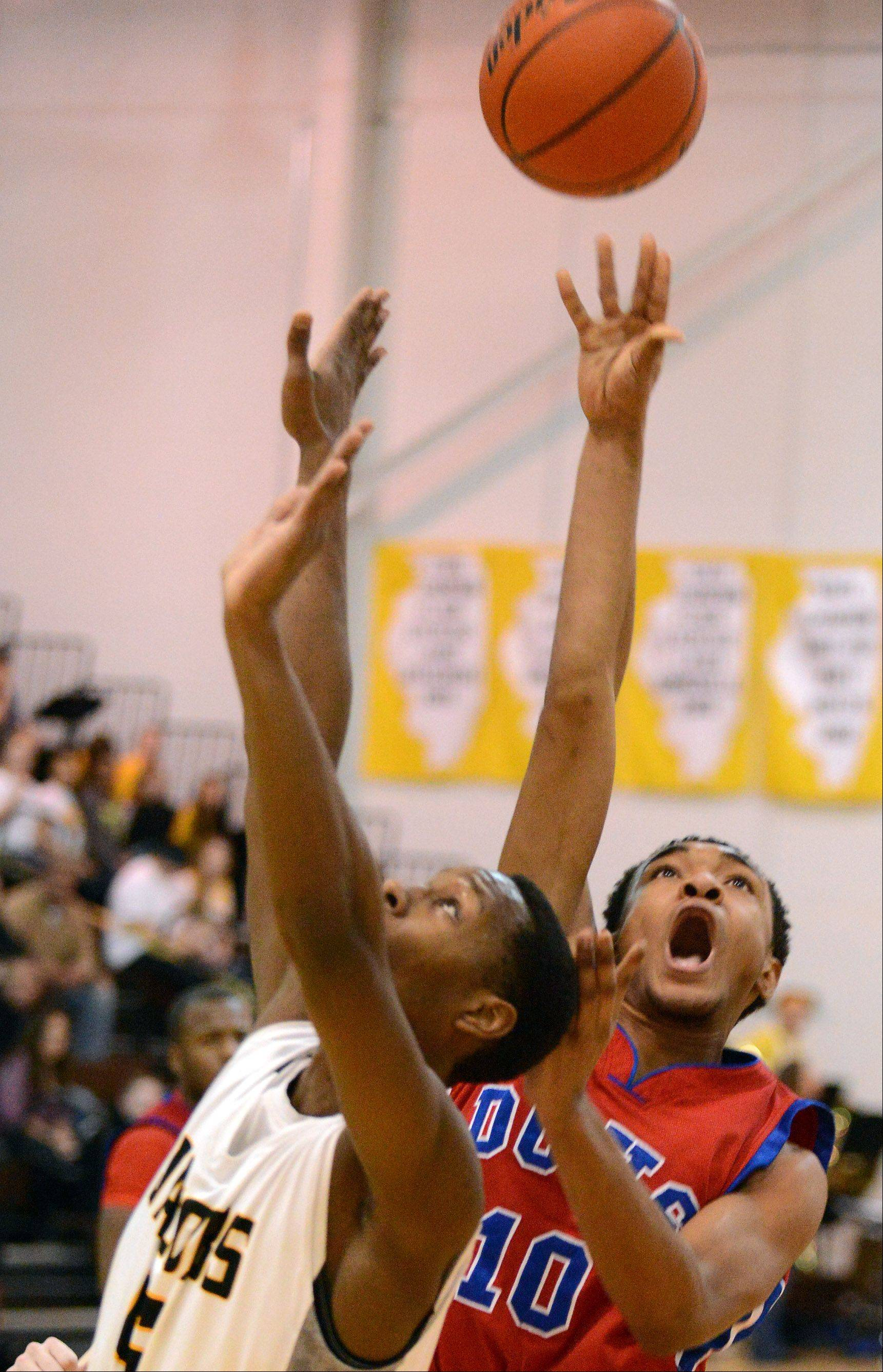 Dundee-Crown's Kiwaun Seals puts up a shot against Jacobs during Wednesday's game in Algonquin.