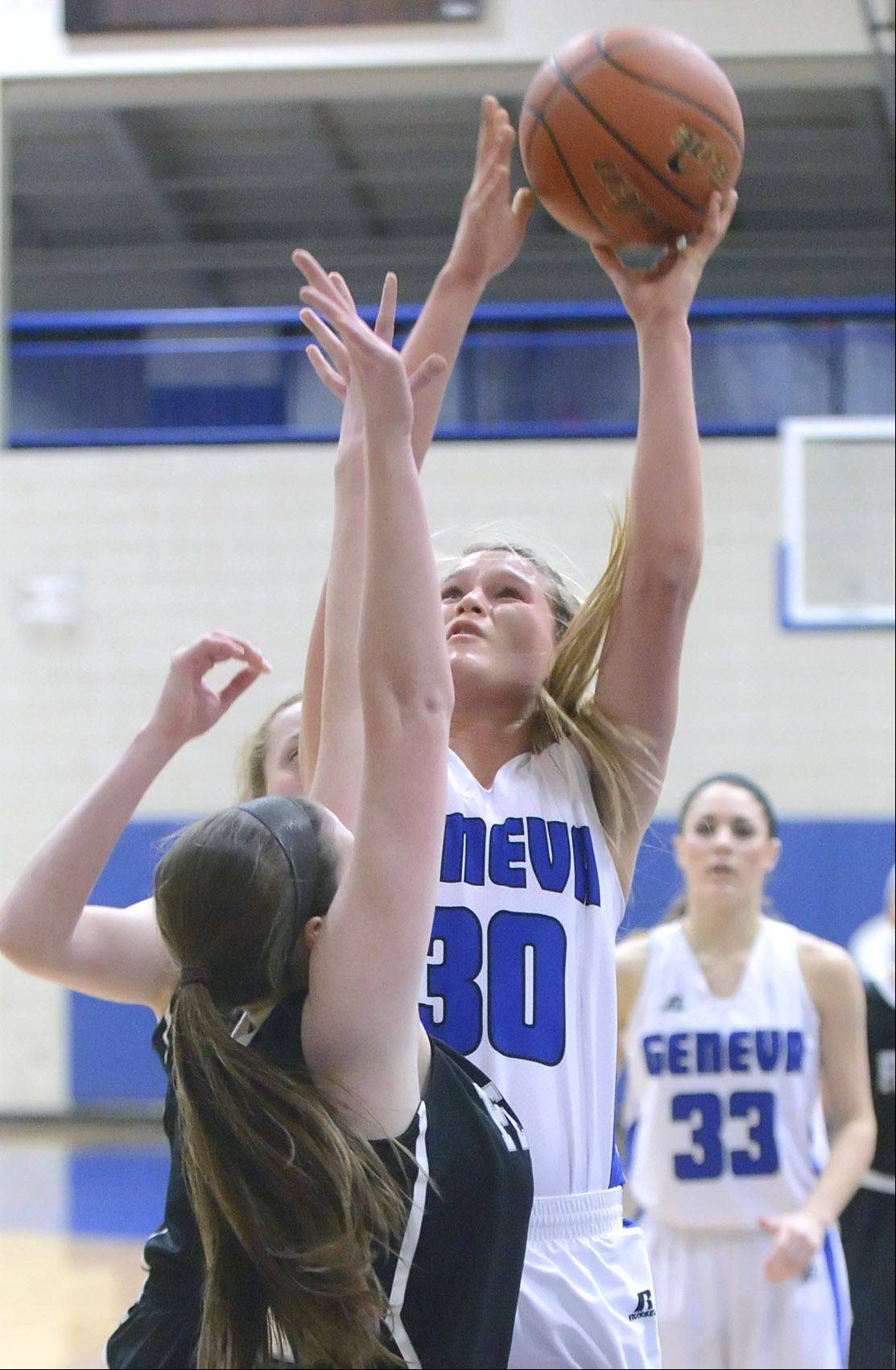 Geneva's Janie McCloughan shoots over a block by Fenwick's Megan Hussey in the second quarter.