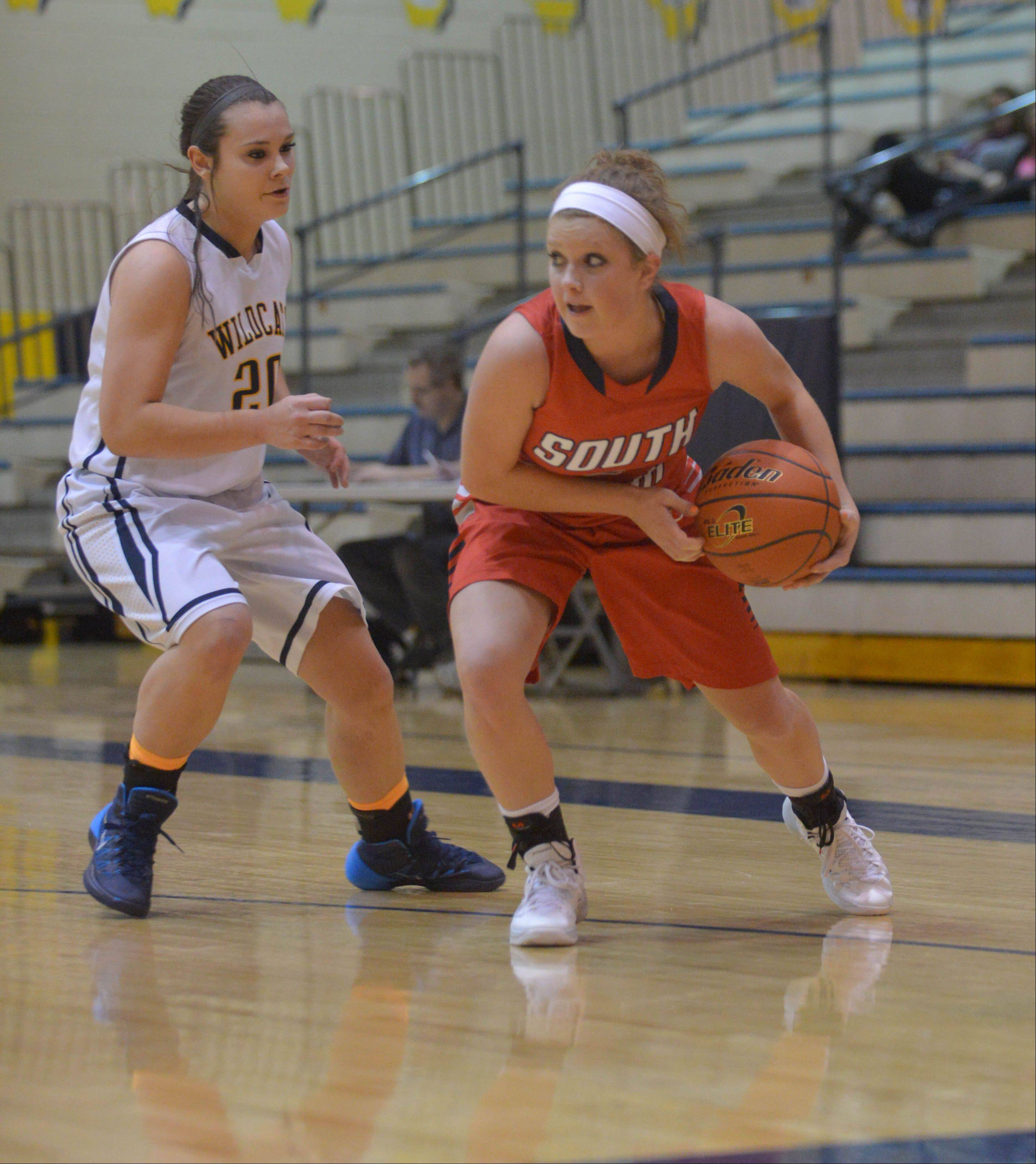 Niki Lazar of Neuqua Valley and Anna Tracy of South Elgin move with the ball.