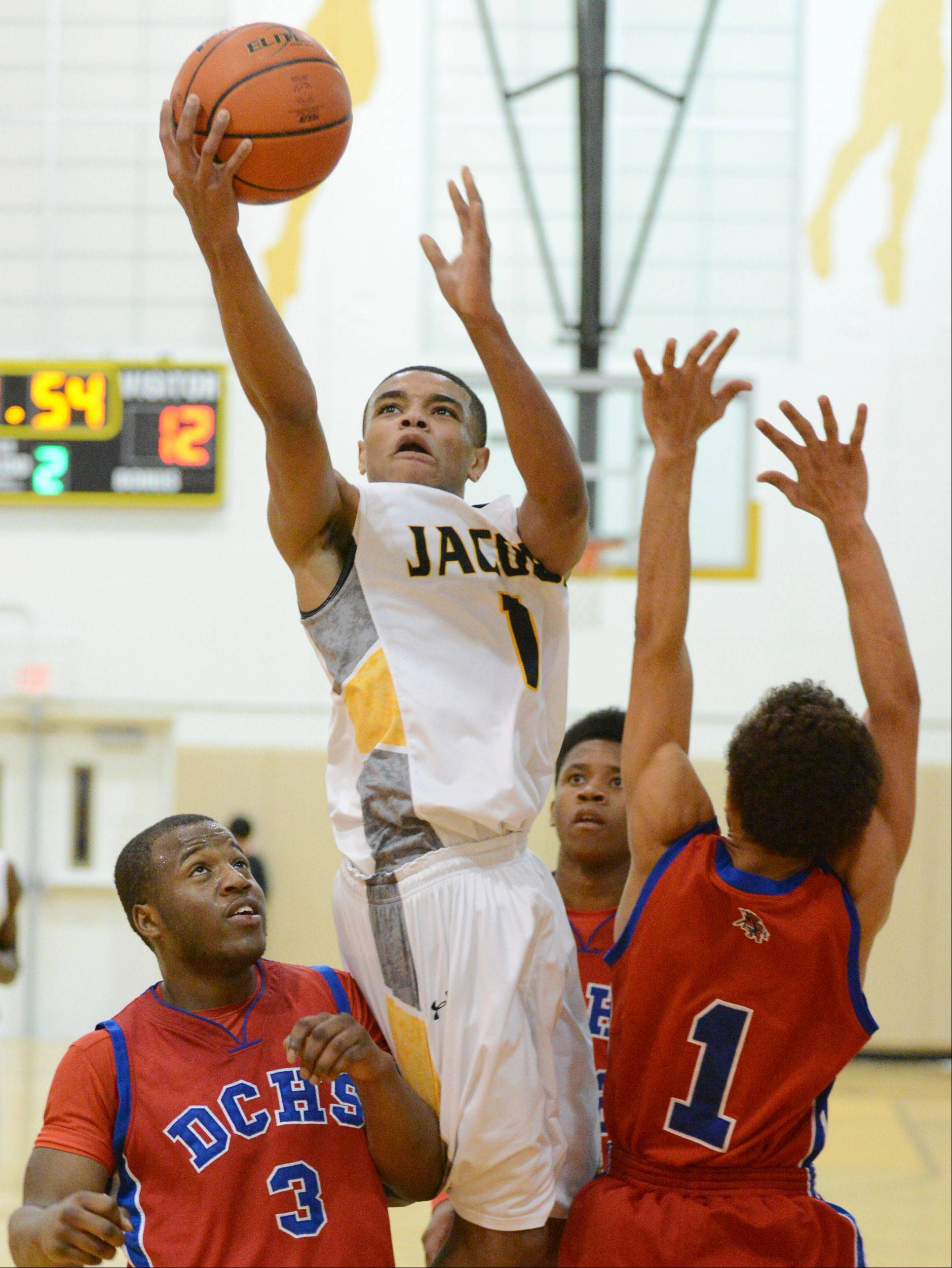 Kenton Mack of Jacobs glides between three Dundee-Crown defenders en route to a layup.