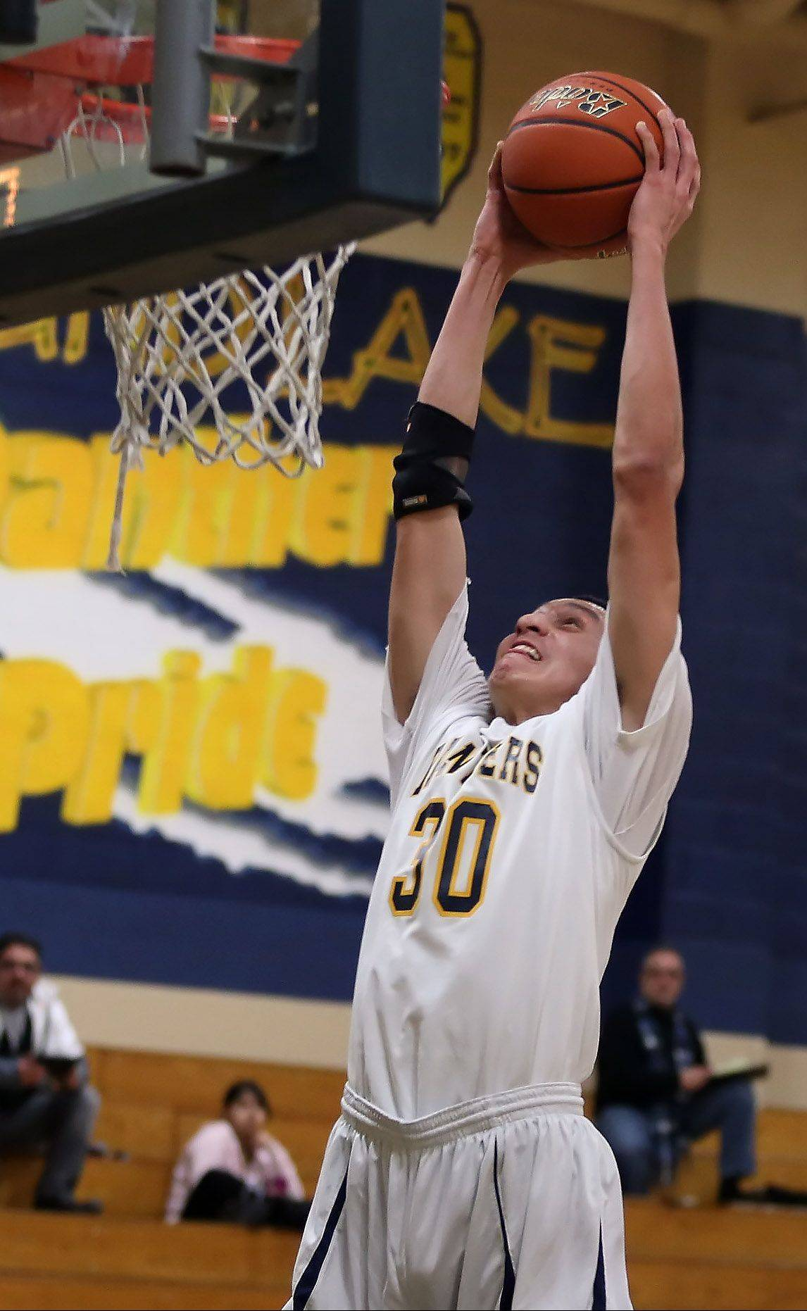 Round Lake forward Mateusz Lopez dunks the ball against visiting Northtown Academy on Thursday.