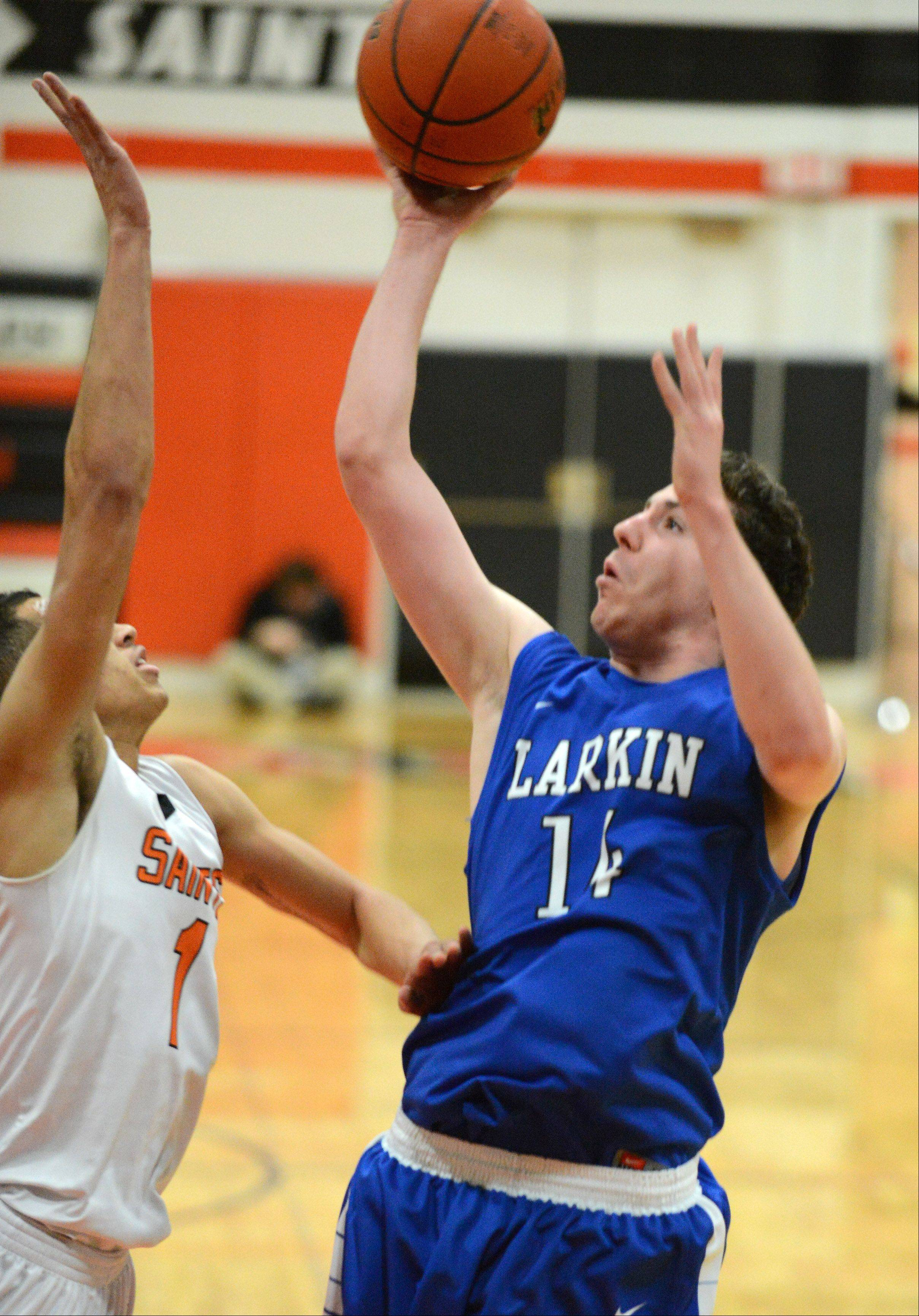 Larkin's Andrew Jones (14) shoots over St. Charles East's AJ Washington (1) during Thursday's game in St. Charles.