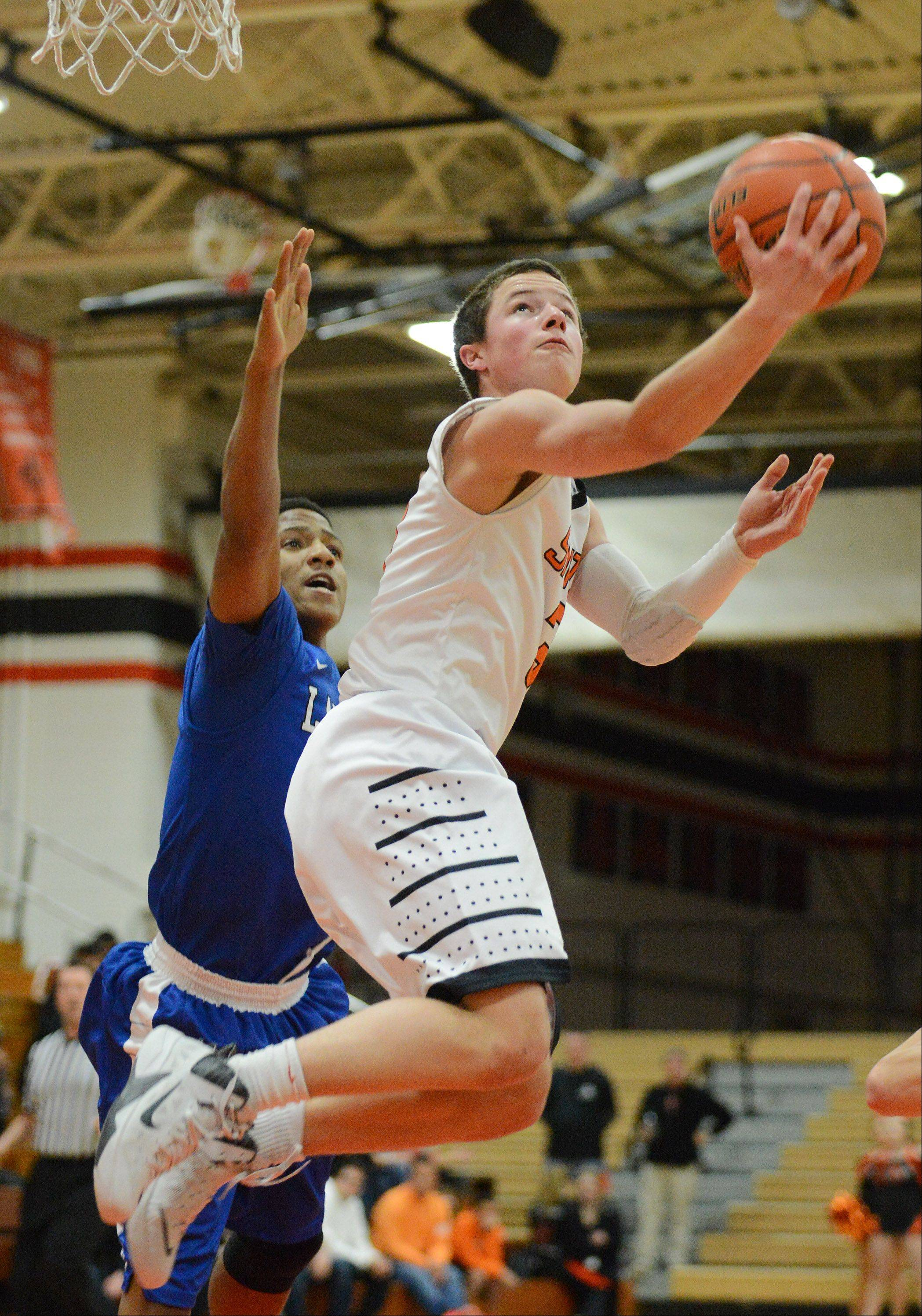 St. Charles East's Cole Gentry (3) goes up for a reverse layup against Larkin during Thursday's game in St. Charles.