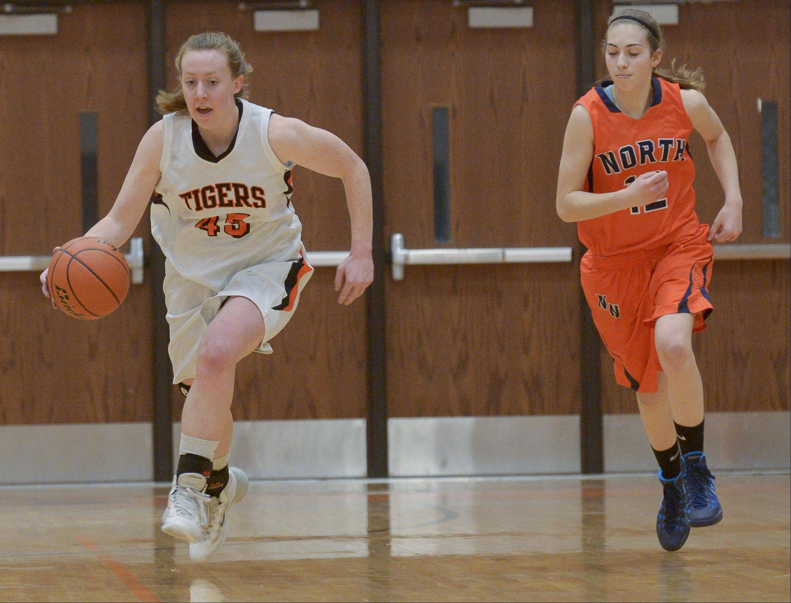Wheaton Warrenville South's Meghan Waldron drives the ball down the court.
