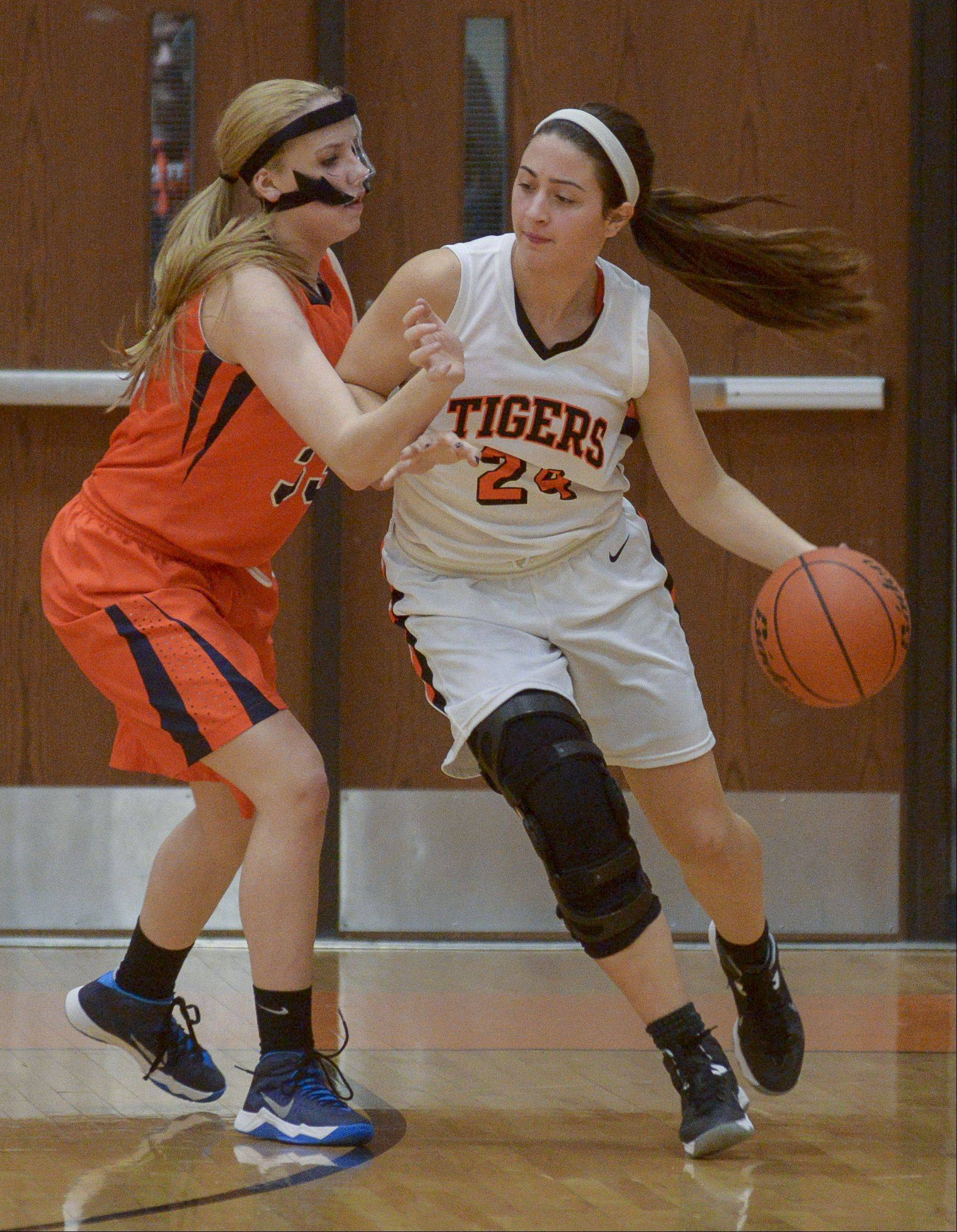 Naperville North's Katie Cores guards Wheaton Warrenville South's Maggie Dansdill.