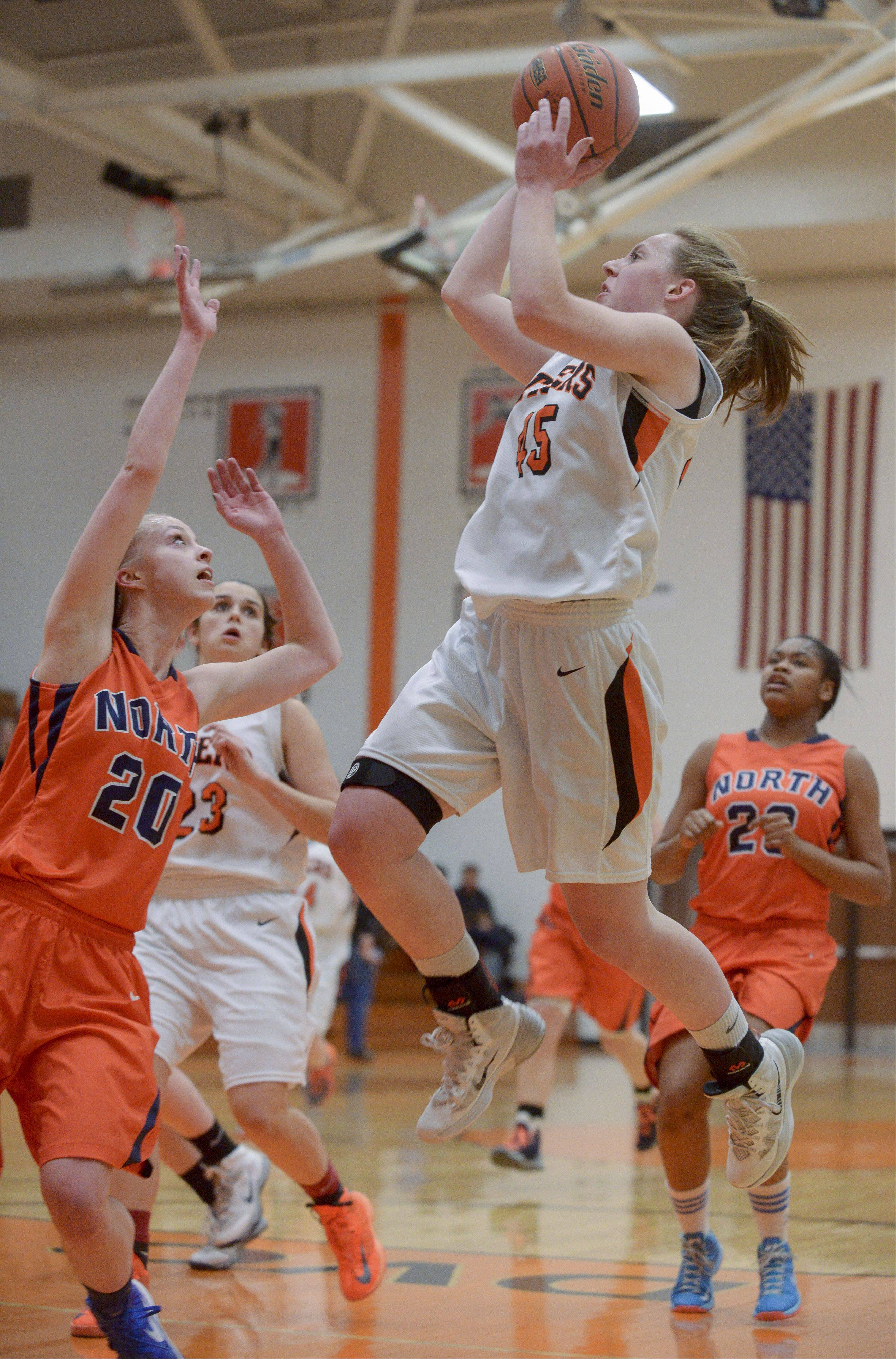 Wheaton Warrenville South's Meghan Waldron takes a shot against Naperville North's Caleigh Corbett.