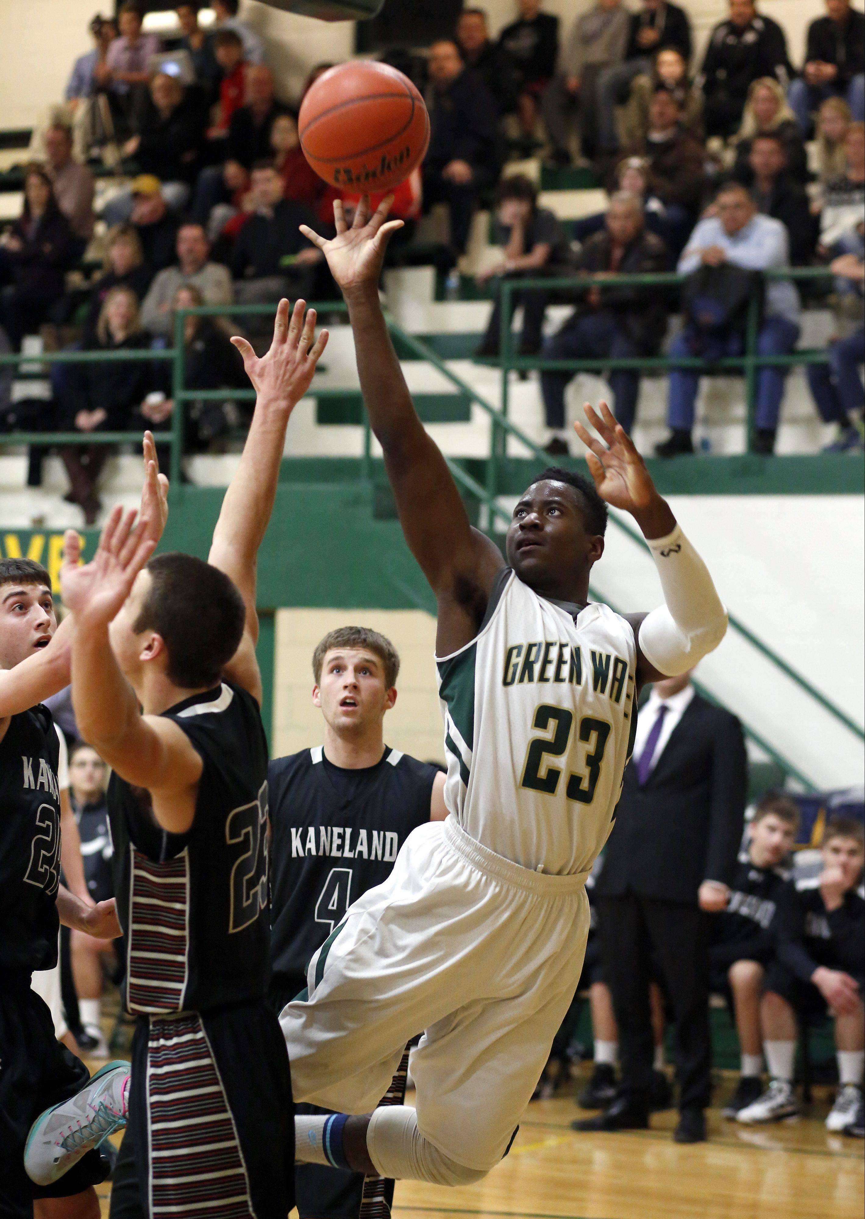 St. Edward's Davontae Elam (23) goes strong to the basket against Kaneland Friday in Elgin.
