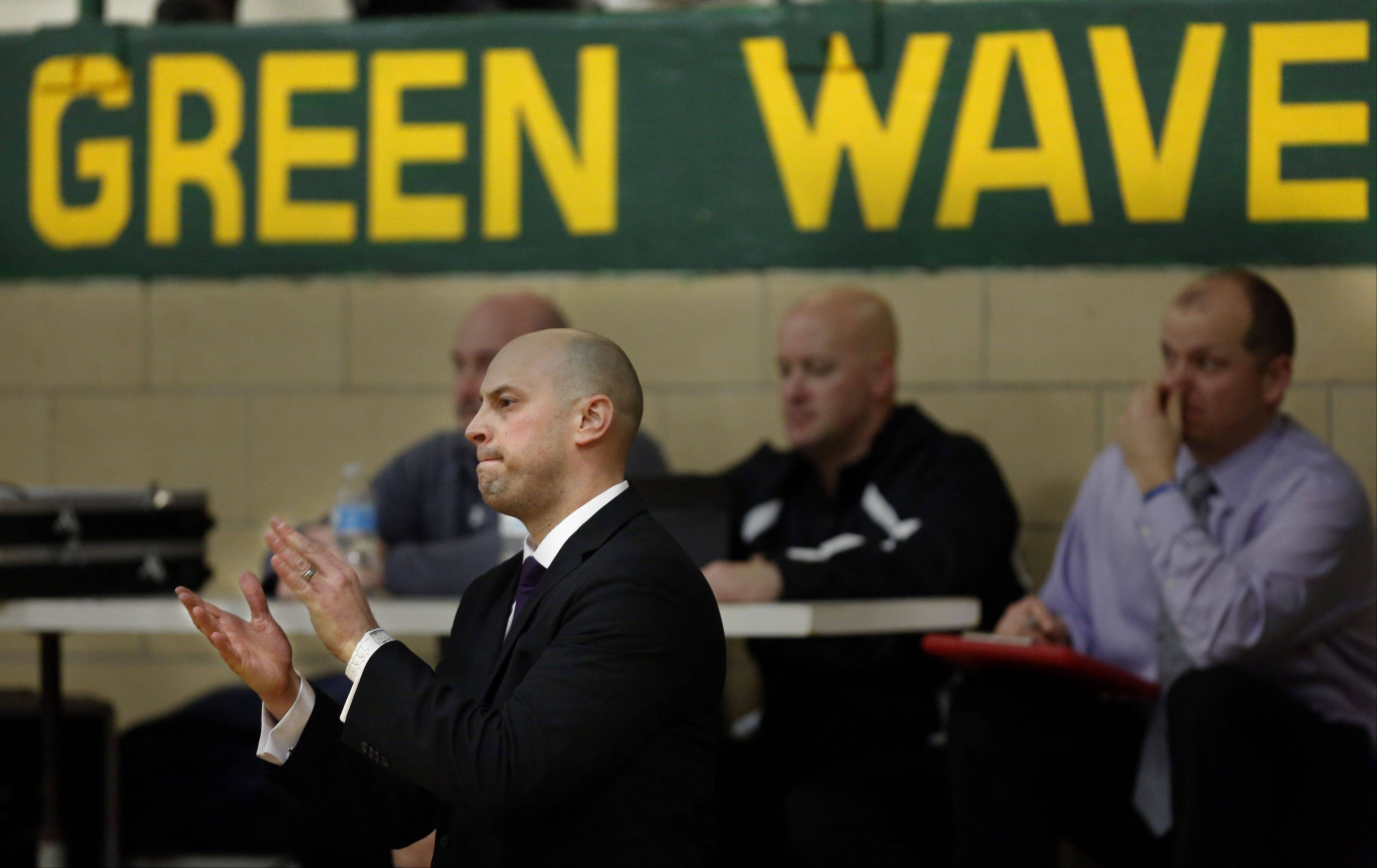 Former St. Edward player and current Kaneland coach Brian Johnson during the Kaneland at St. Edward boys basketball game Friday in Elgin.