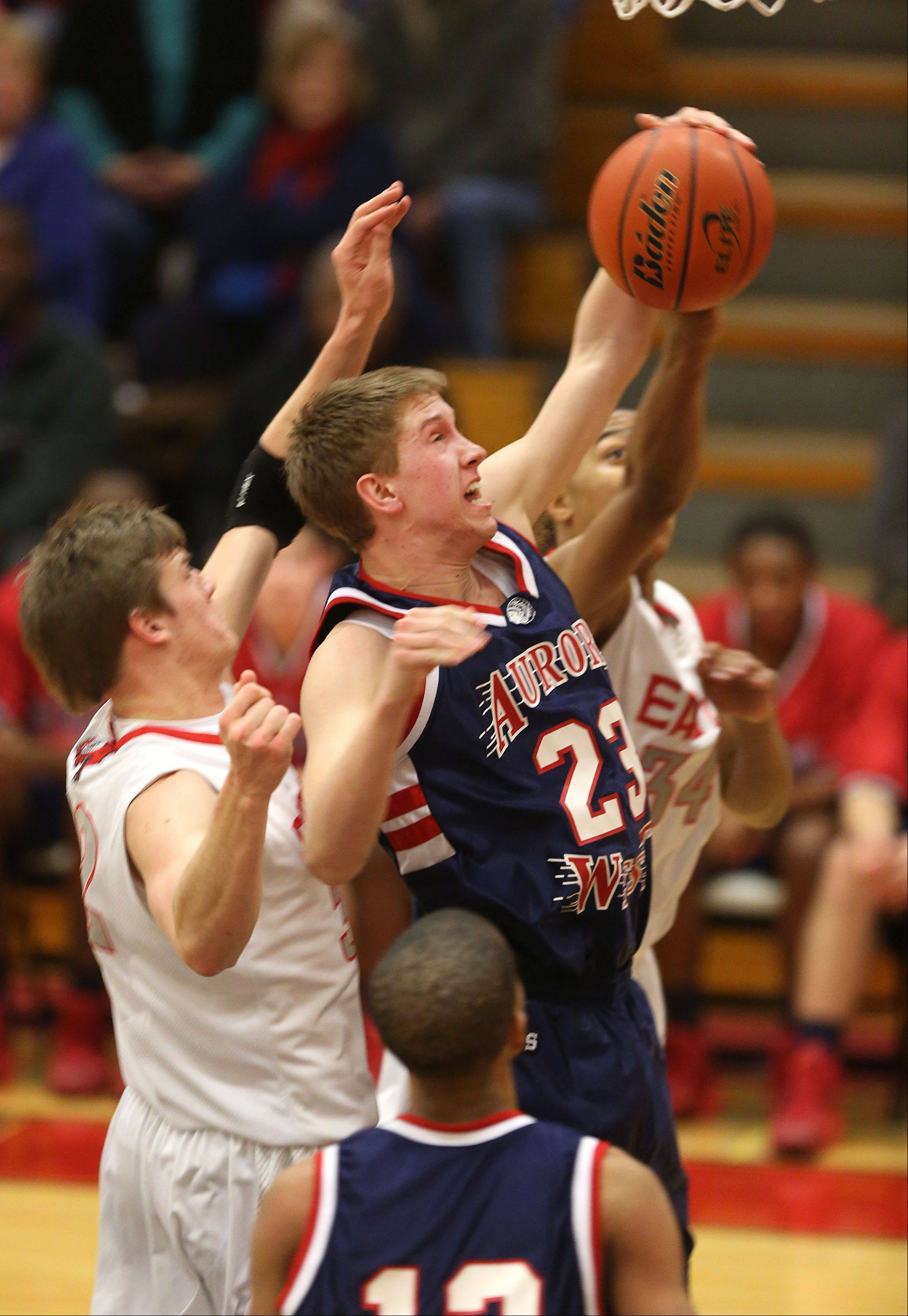 West Aurora's Tommy Koth grabs a defensive rebound against Glenbard East.