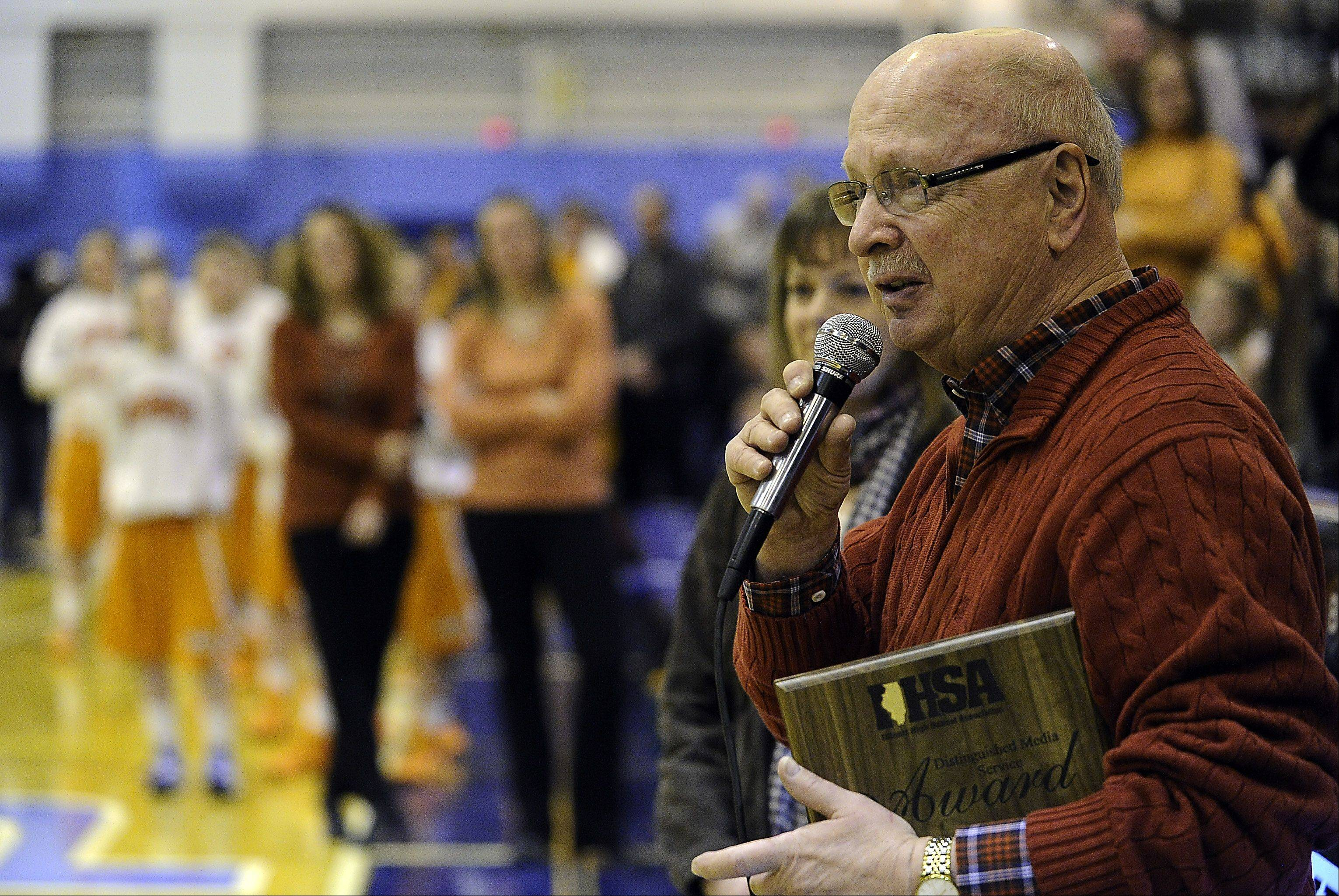 Sports writer Bob Frisk thanks the crowd at Prospect High School for their support Friday in the Jean Walker Field House. He is among the first recipients to of the IHSA's Distinguished Media Service Award.