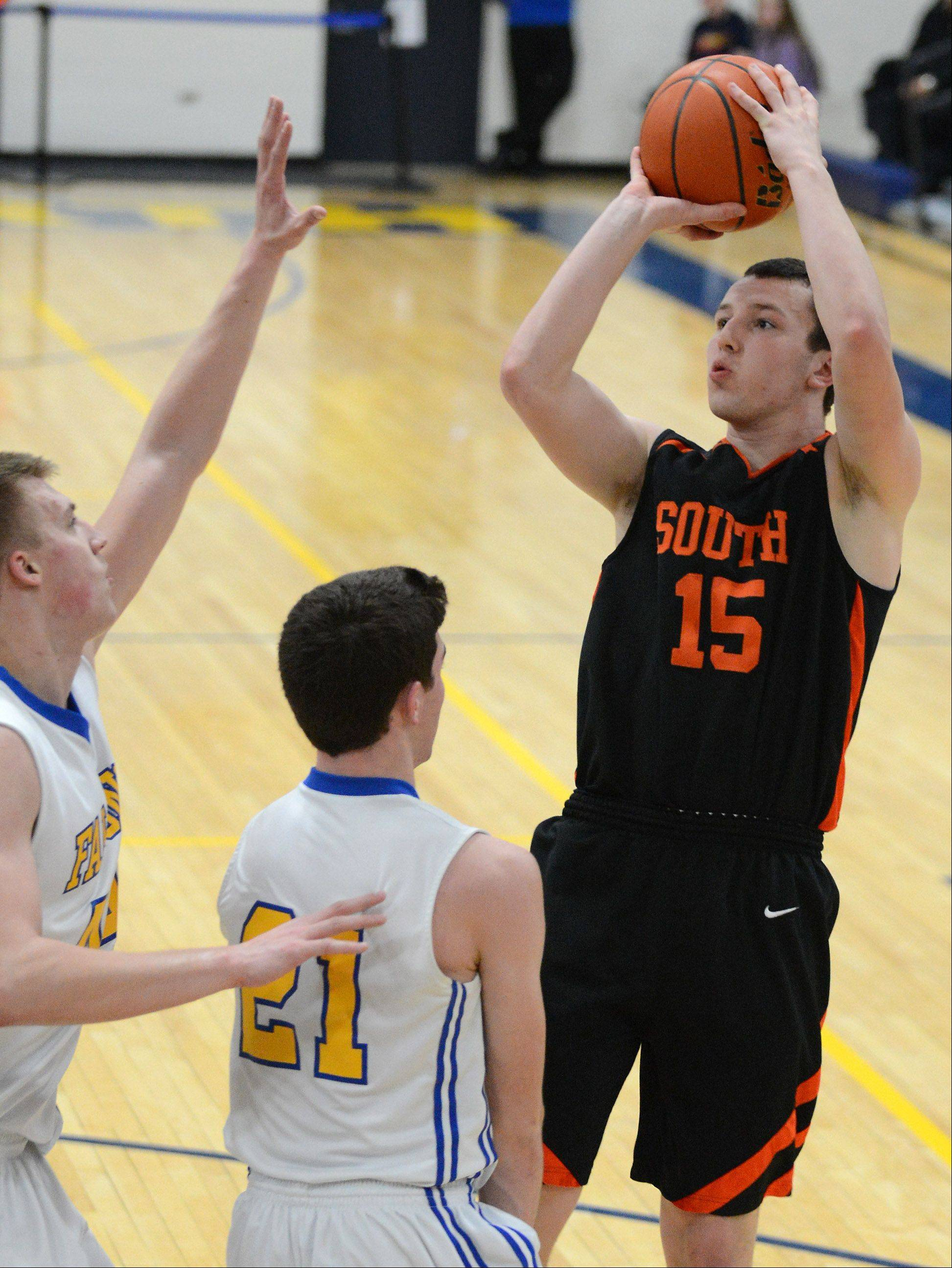 Wheaton Warrenville South's Joe Metzger shoots from the outside.