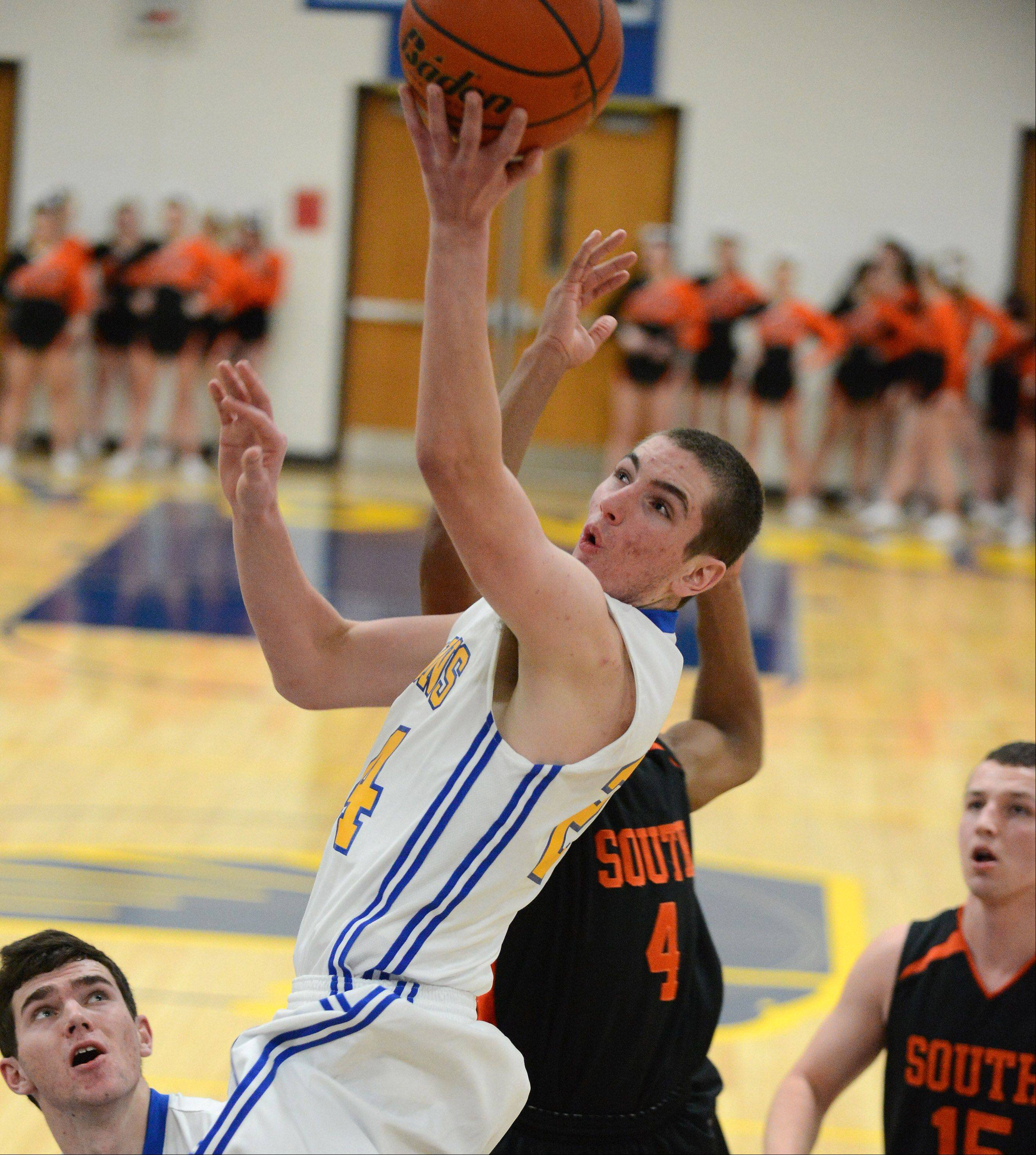 Wheaton North's Nick Traversa glides to the basket against Wheaton Warrenville South.