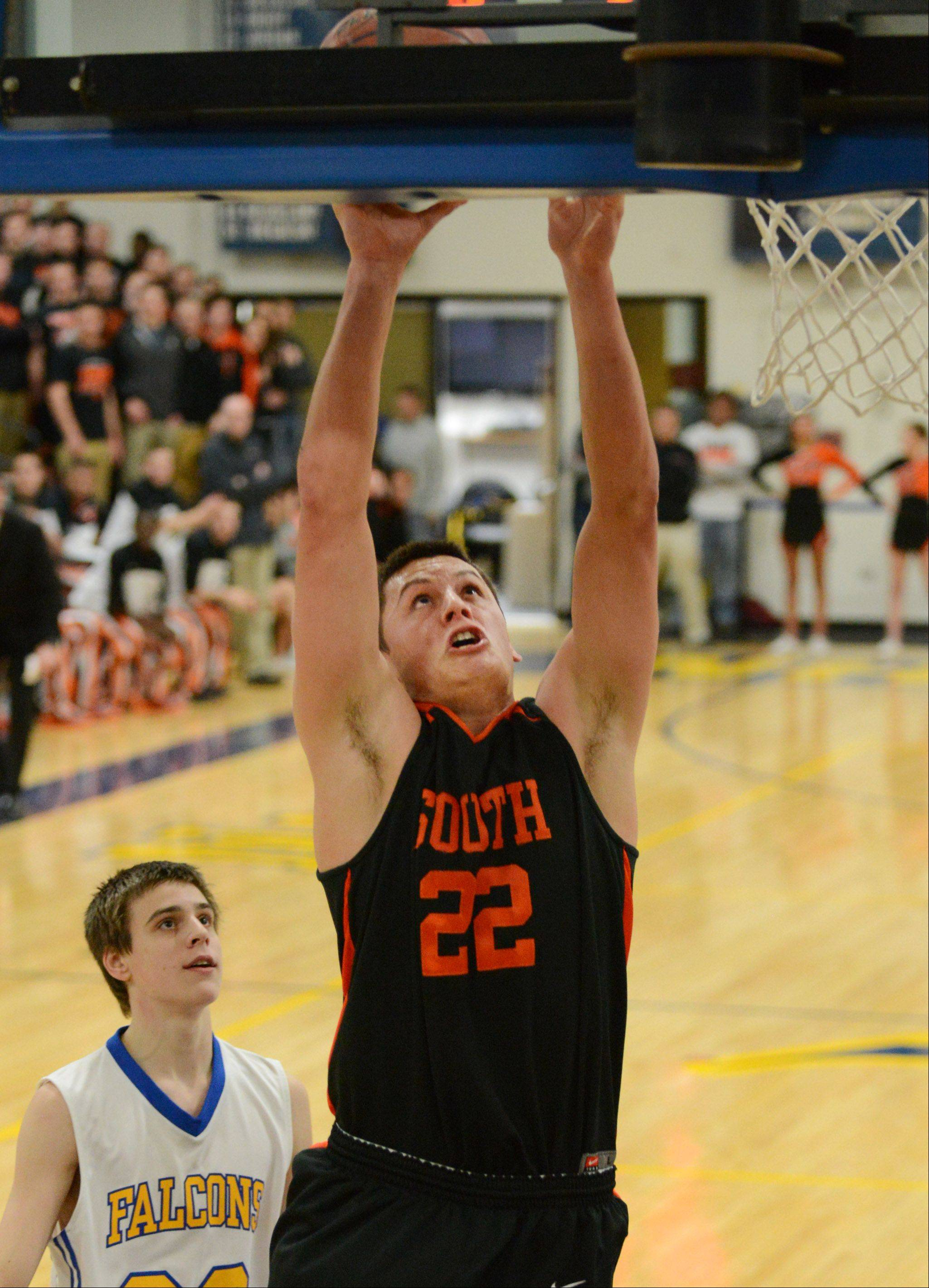 Wheaton Warrenville South's Aidan Hernandez scores on a breakaway layup.
