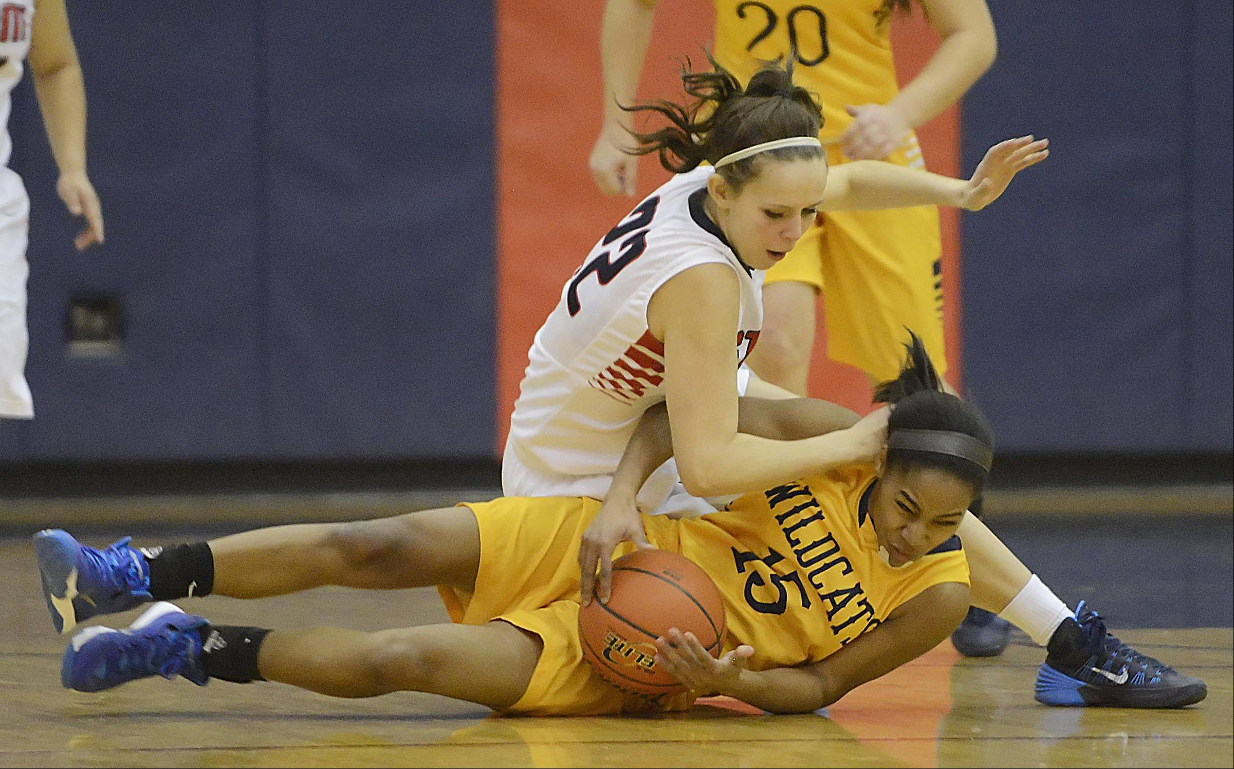 South Elgin's Laura McIntosh falls over Neuqua Valley's Malia Smith Monday as they chase a loose ball in South Elgin.