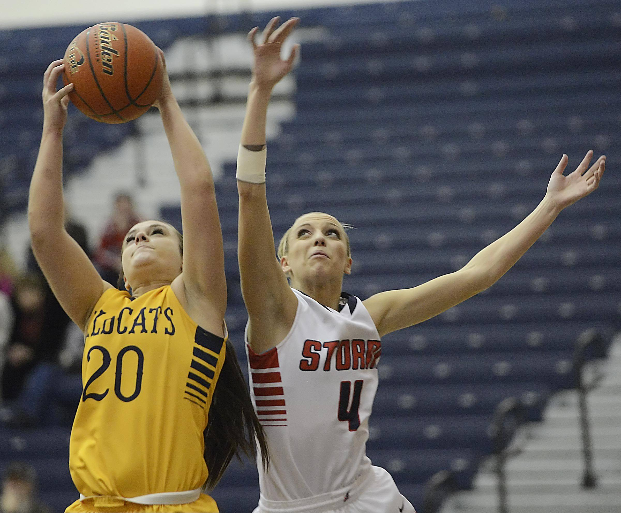 Neuqua Valley's Niki Lazar takes a rebound from South Elgin's Savanah Uveges Monday in South Elgin.