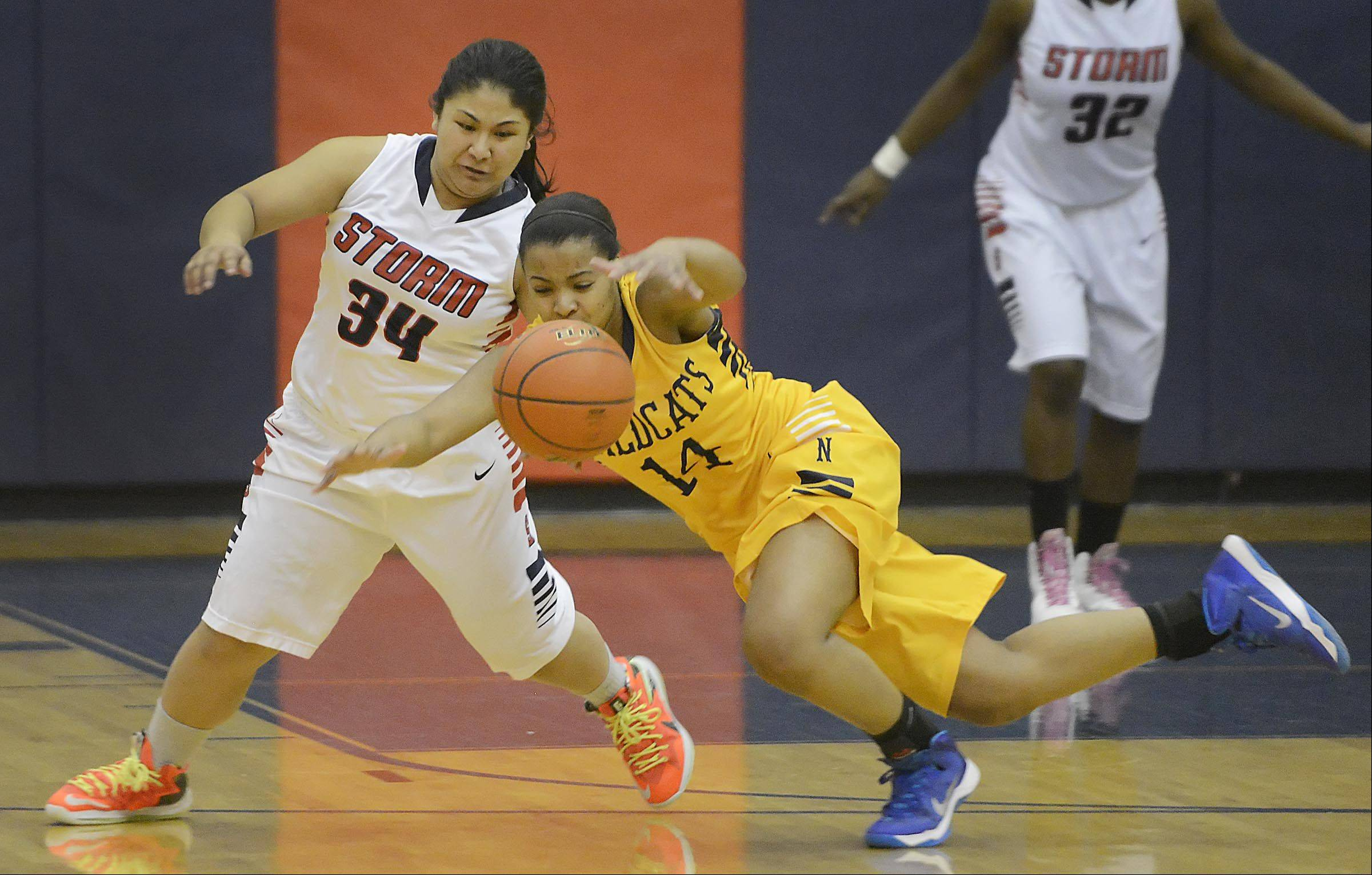 Neuqua Valley's Najee Smith falls as South Elgin's Nadia Yang defends her Monday in South Elgin.
