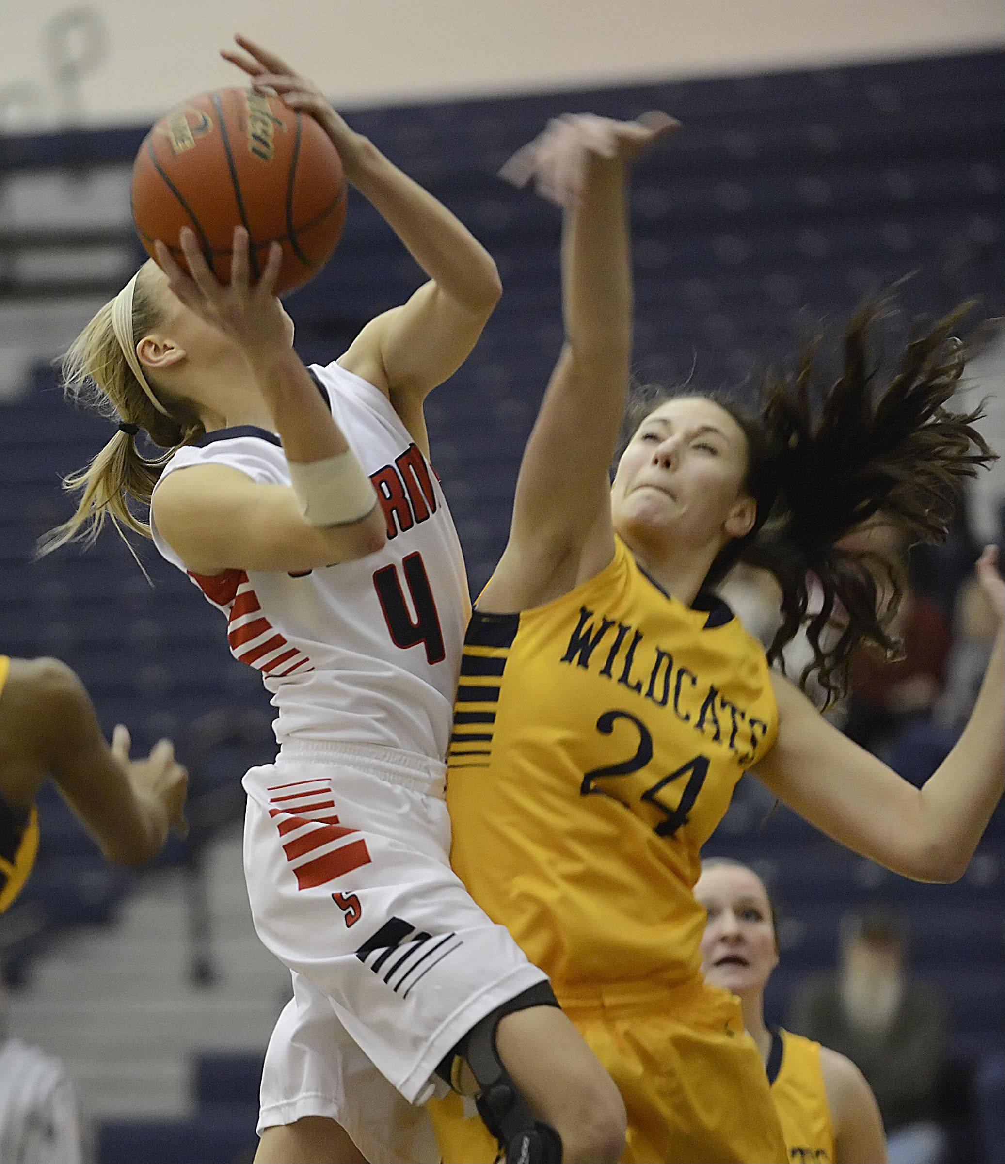 South Elgin's Savanah Uveges is fouled by Neuqua Valley's Bryce Menendez.