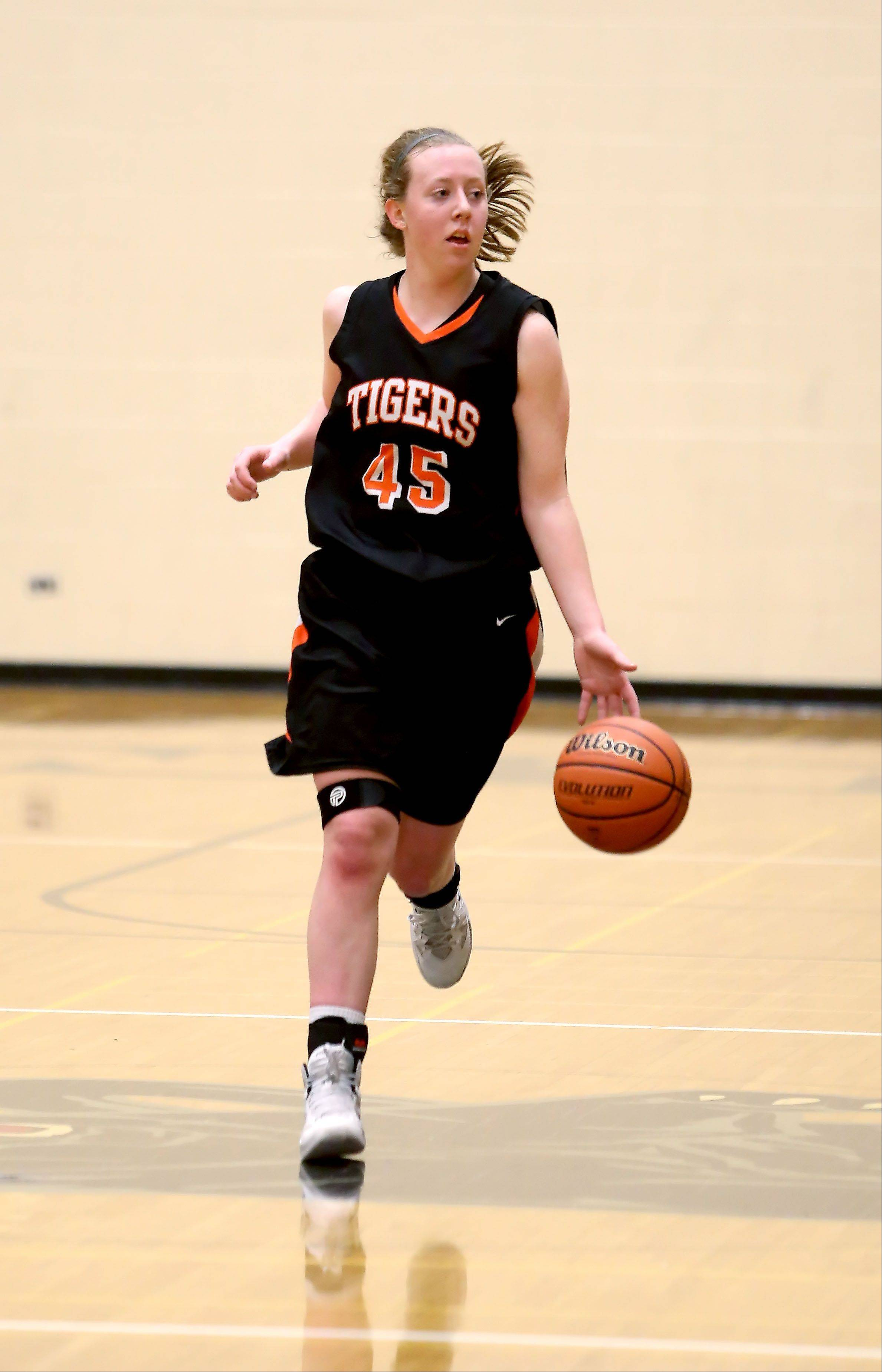 Wheaton Warrenville South's Meghan Waldron moves the ball up the court.