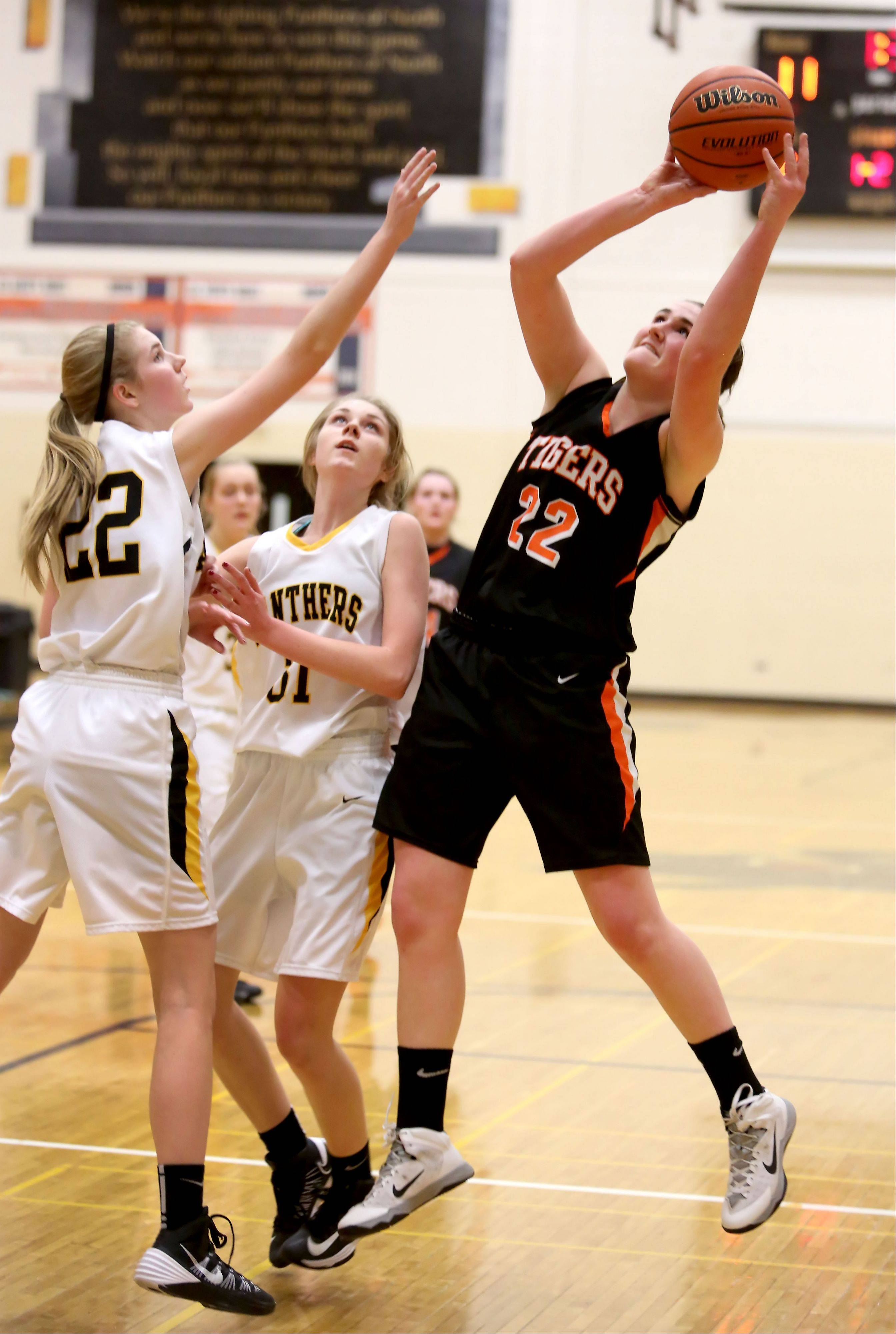 Wheaton Warrenville South's Melinda Franke, right, attempts a basket.