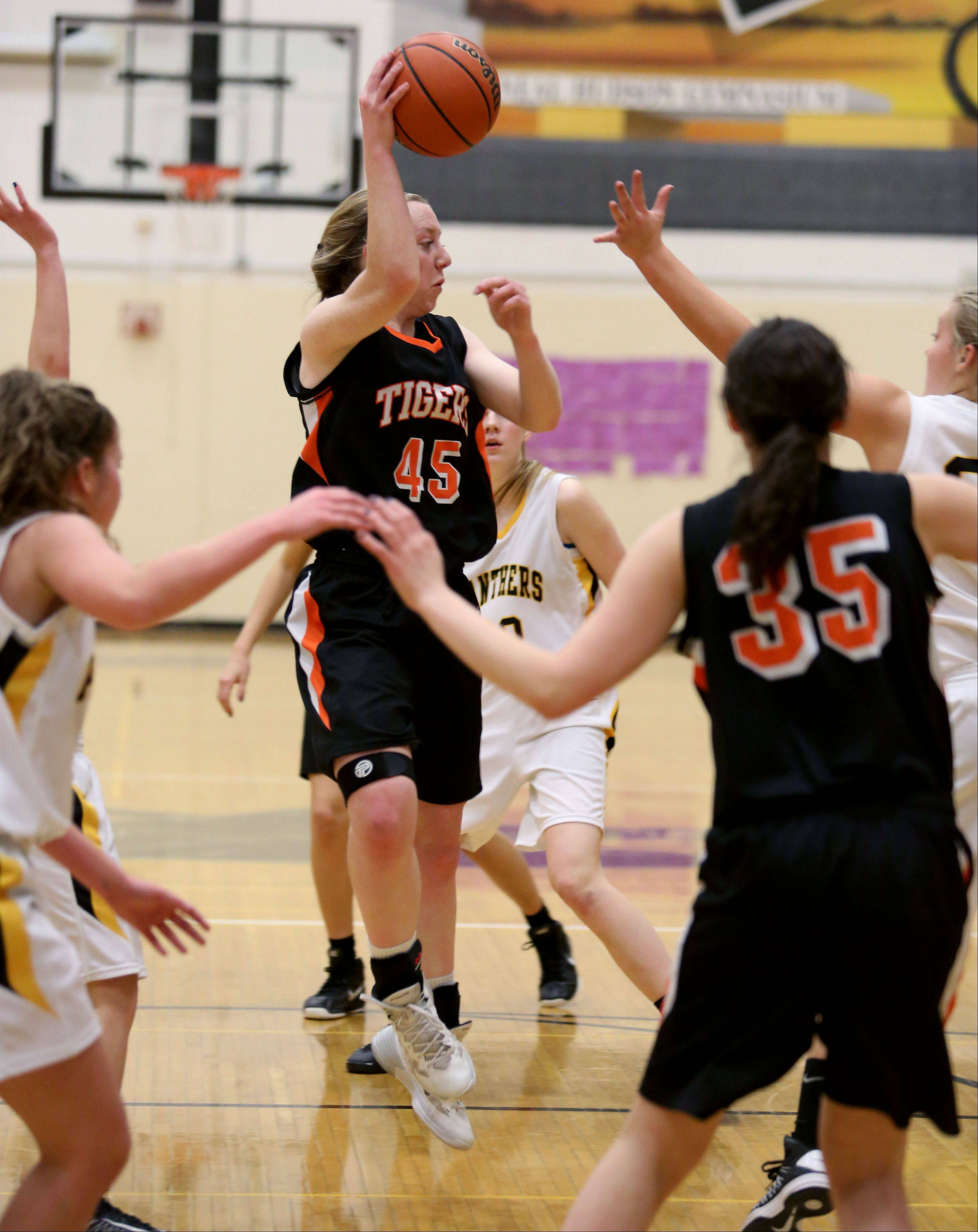 Wheaton Warrenville South's Meghan Waldron passes the ball.