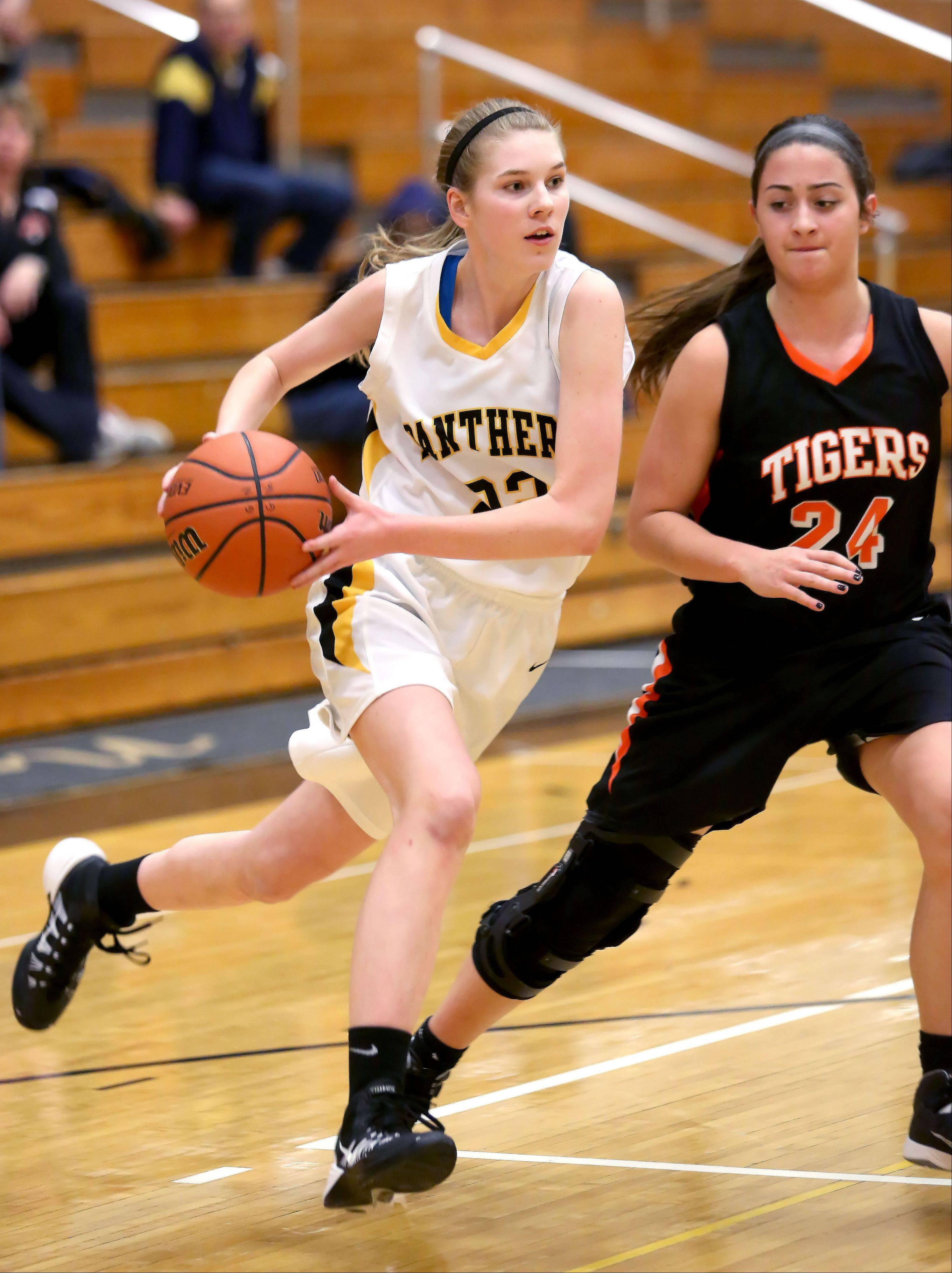 Glenbard North's Jennifer Deegan, left, drives past Maggie Dansdill of Wheaton Warrenville South.
