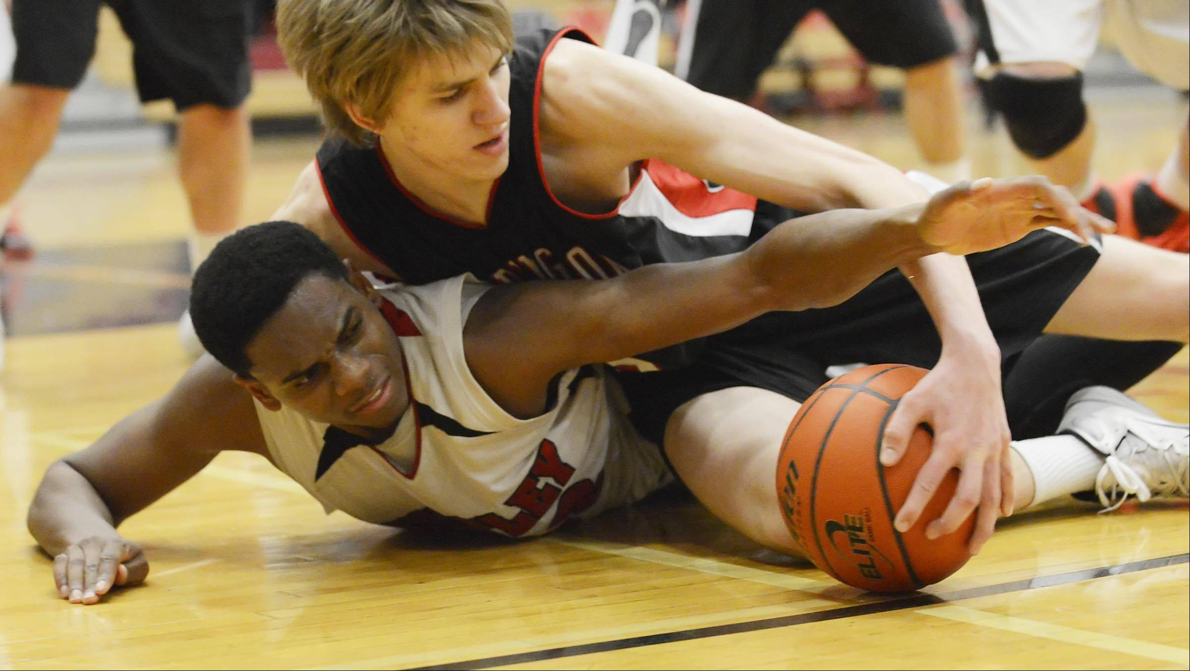 Huntley's Amanze Egekeze and Barrington's Rapolas Ivanauskas fight for a loose ball Tuesday in Huntley.