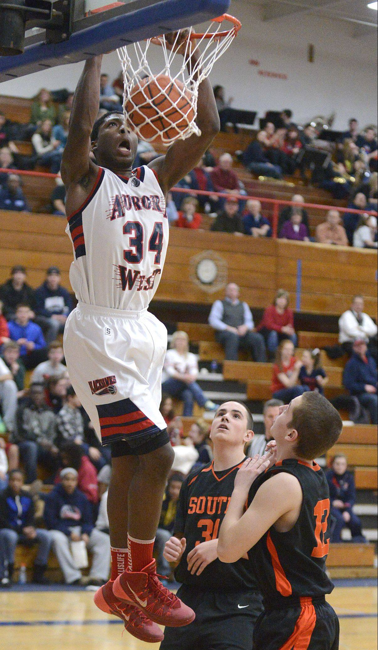 West Aurora's Roland Griffin slams home one of his two first-half dunks Tuesday night against Wheaton Warrenville South in Aurora.