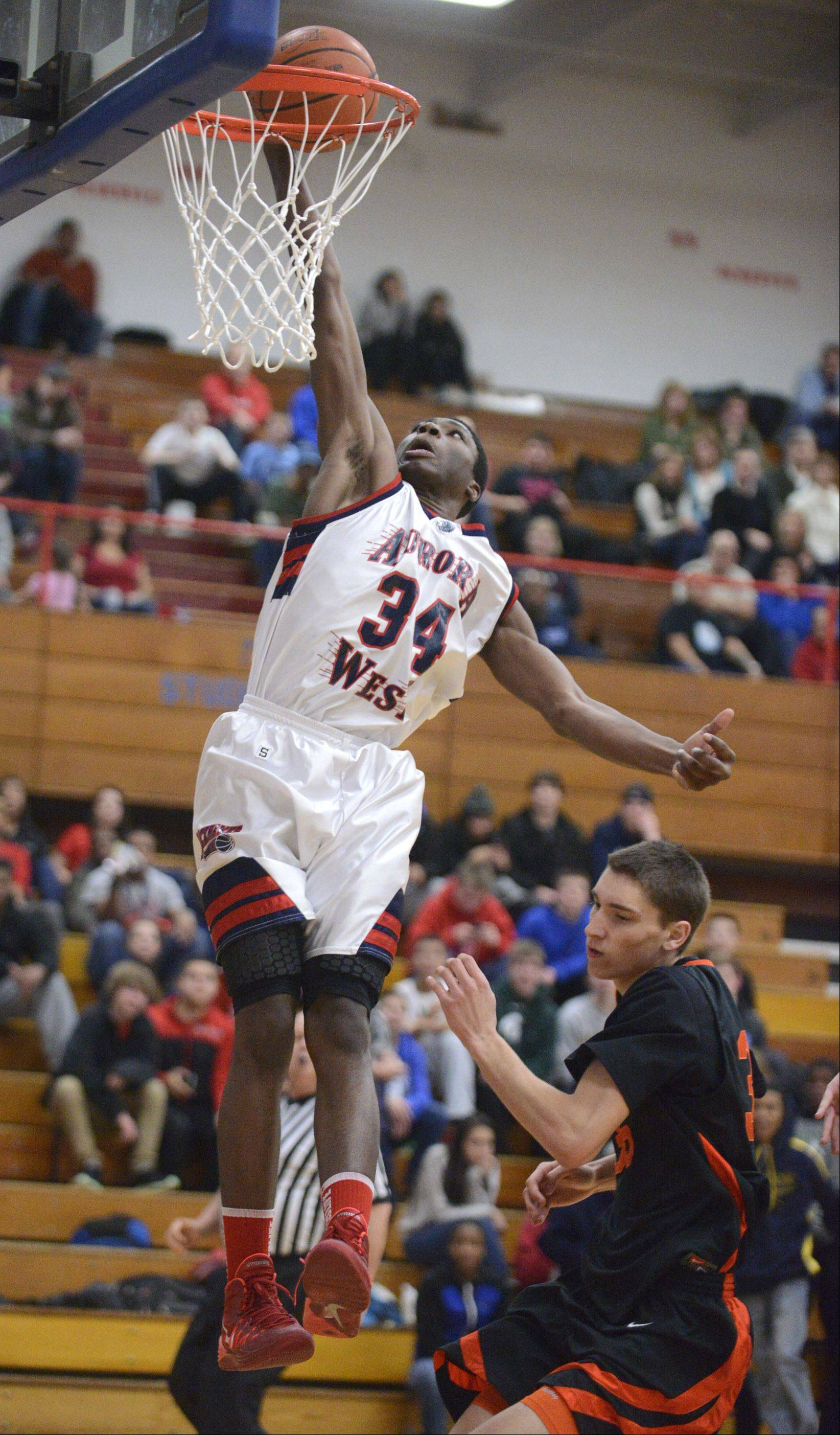 West Aurora's Roland Griffin sinks another shot over Wheaton Warrenville South in the second quarter on Tuesday, February 4.