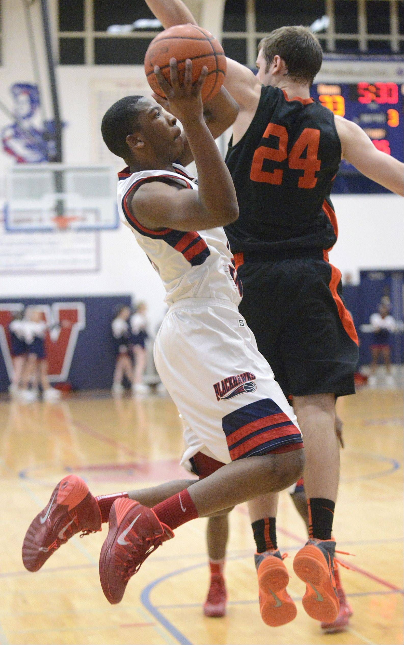 Wheaton Warrenville South's Matt Kienzle can't block a shot by West Aurora's Jontrell Walker in the third quarter on Tuesday, February 4.