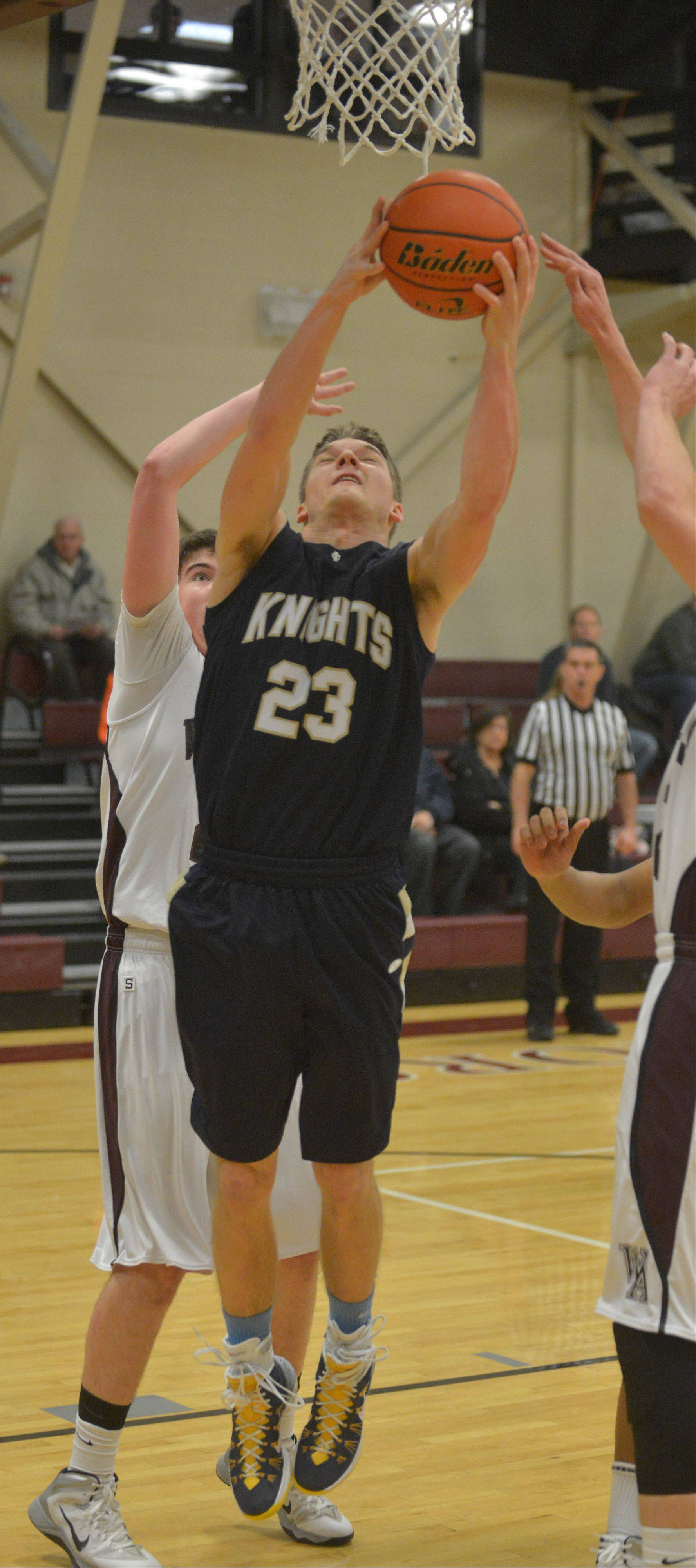 Bennett Fuzak of Wheaton Academy takes a shot.