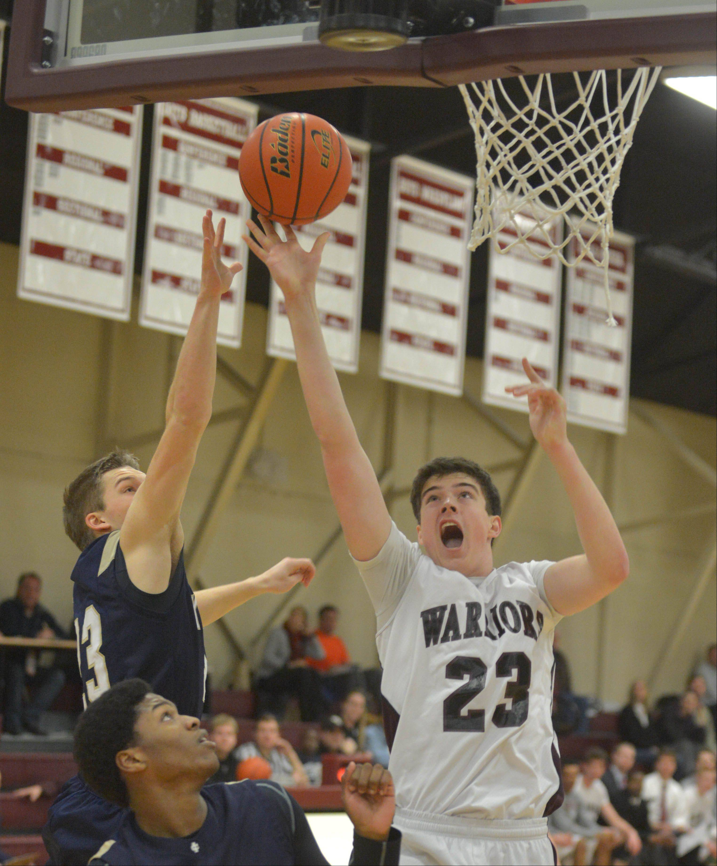 Clark Brinkman of IC Catholic Prep,left, and Bennett Fuzak of Wheaton Academy go for a rebound.