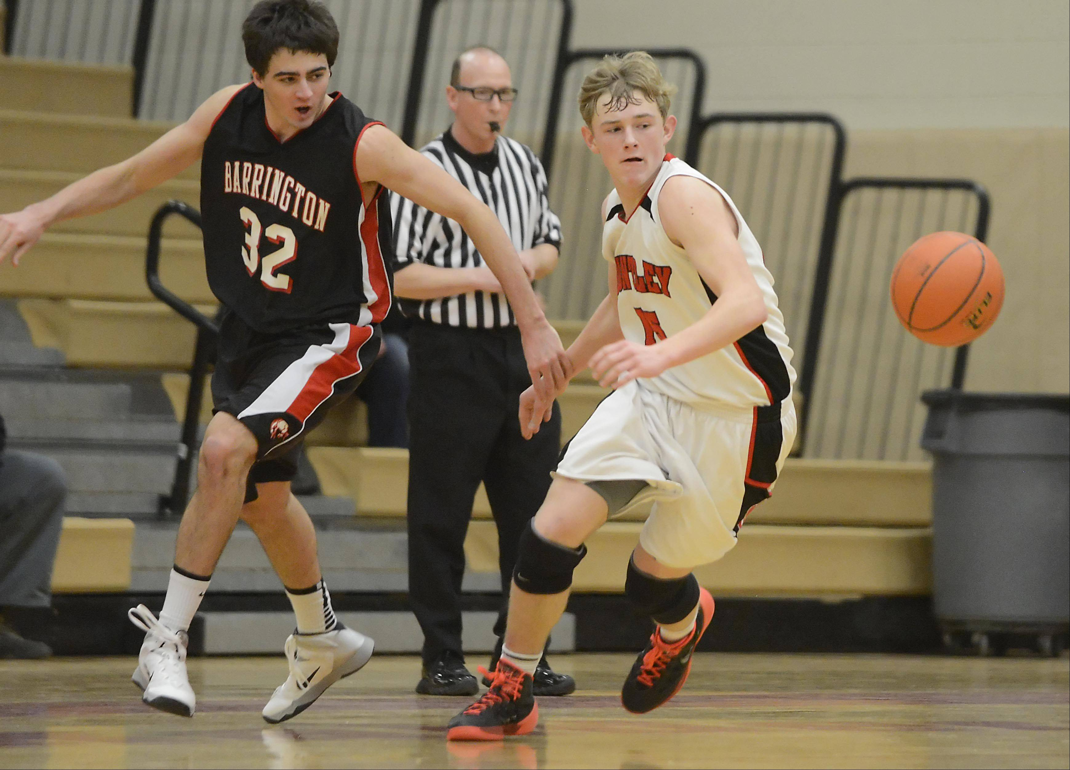 Huntley's Jack Bessey chases the ball after a steal from Barrington's Austin Madrzyk late in the game.