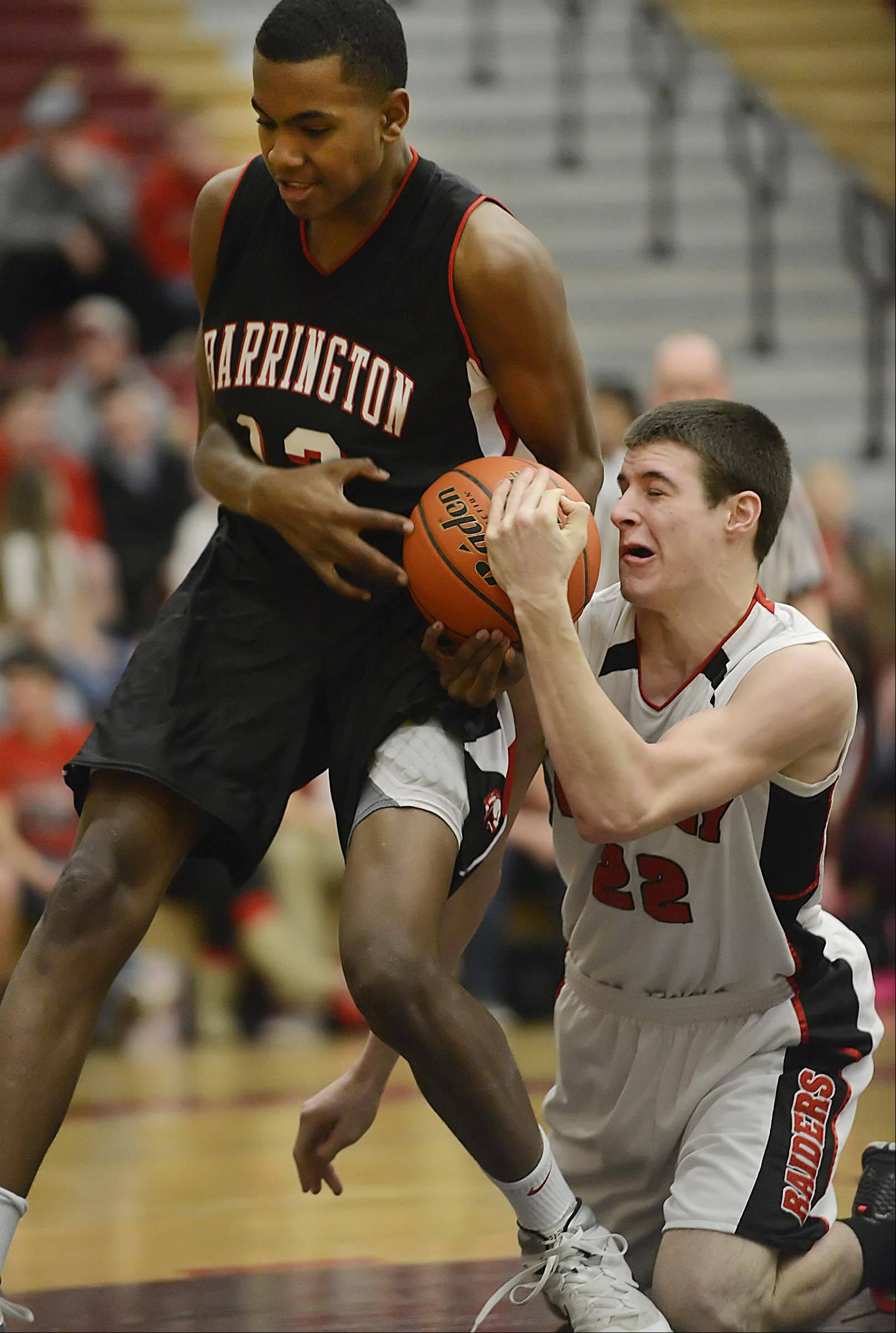 Huntley's Connor Boesch and Barrington's Chris Lester battle for the ball.